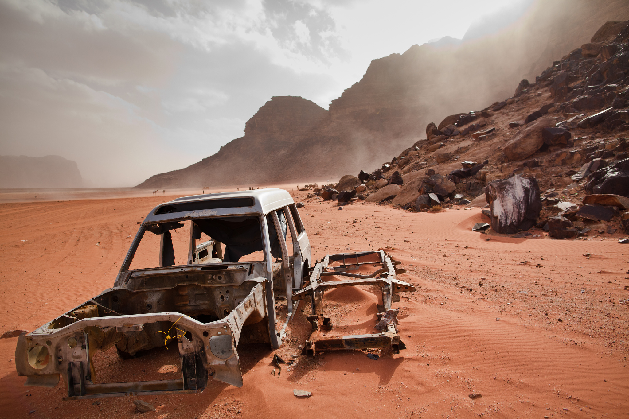 A car chassis lays abandoned in Wadi Rum desert. Image credit:    Eric Montfort   /   Creative Commons