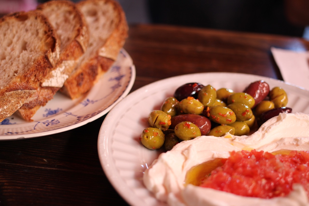 Try delicious local food like hummus and olives in Israel. Image credit:    subherwal   /   Creative Commons