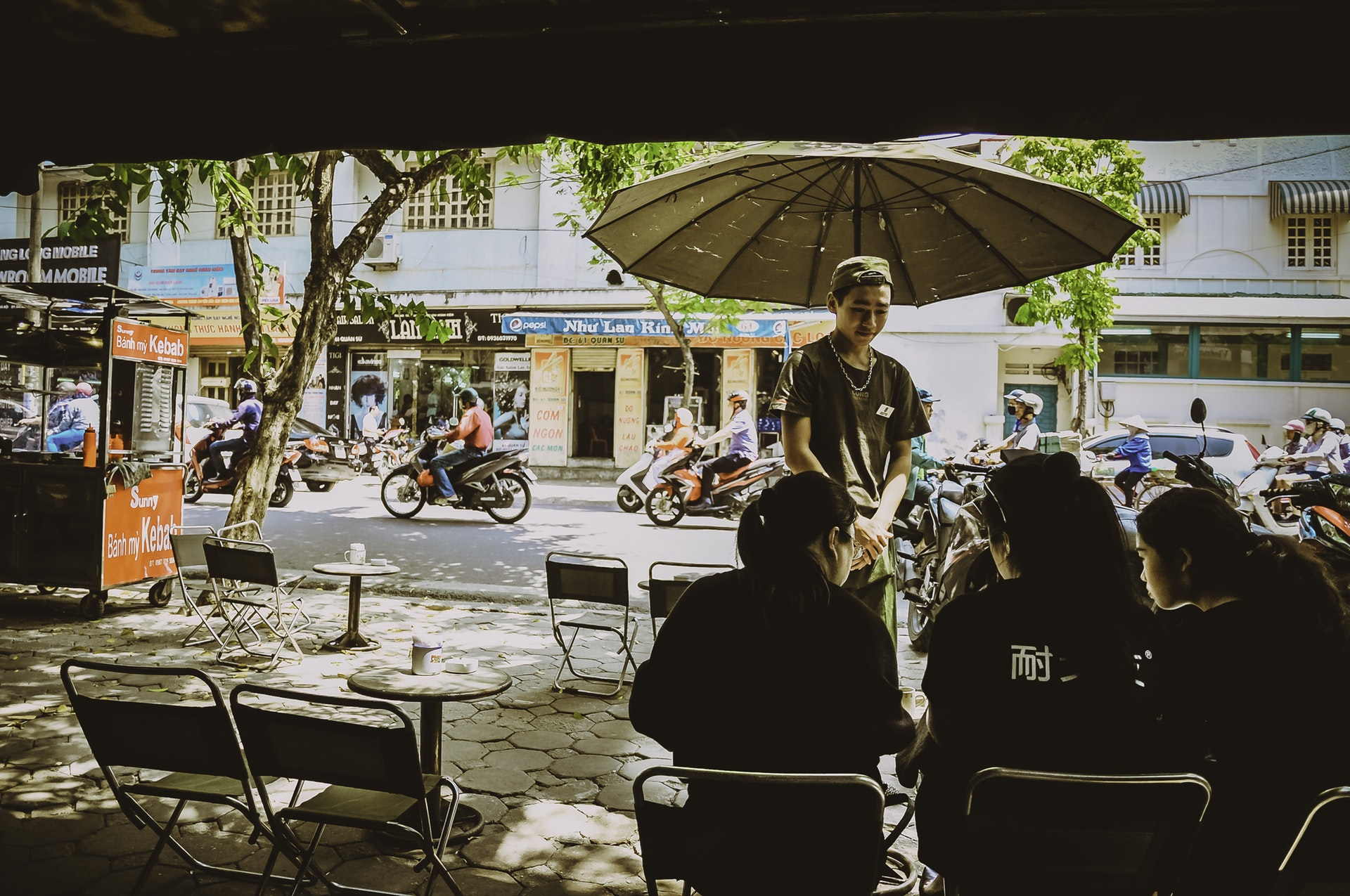 Vietnam-Boy-Street-Umbrella