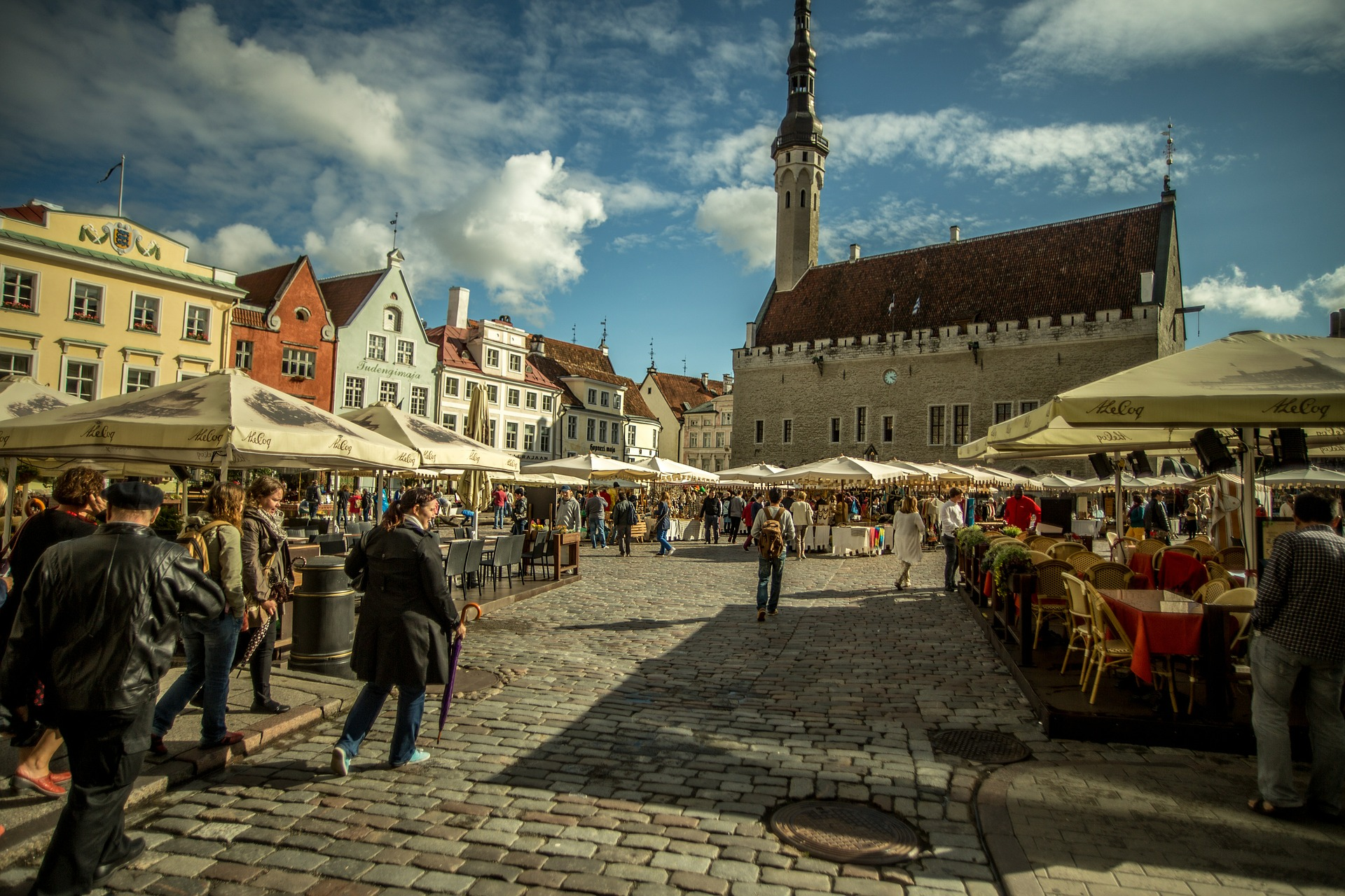 Tallinn's glorious Town Hall Square, soaking up the sun on a busy day.