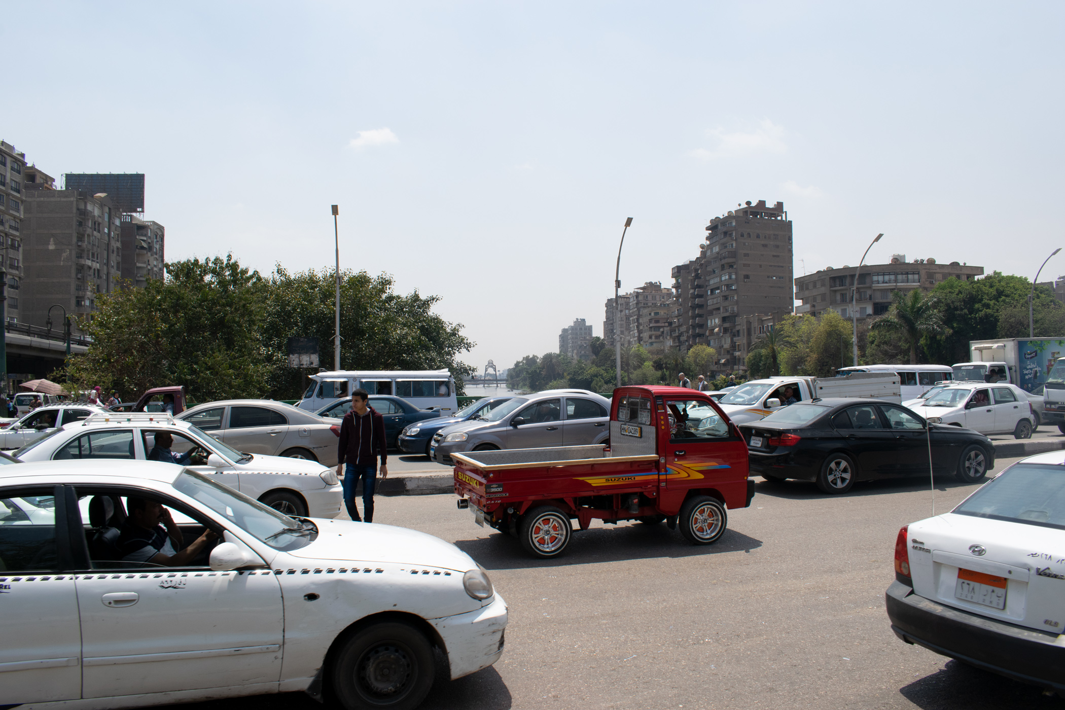Often the scene in Cairo, with pedestrians having to weave in and out of non-stop traffic to cross the road.