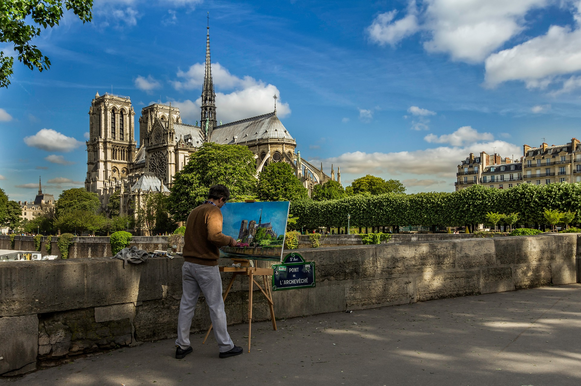 An artist painting Notre-Dame Cathedral before it was ravaged by the recent fire.