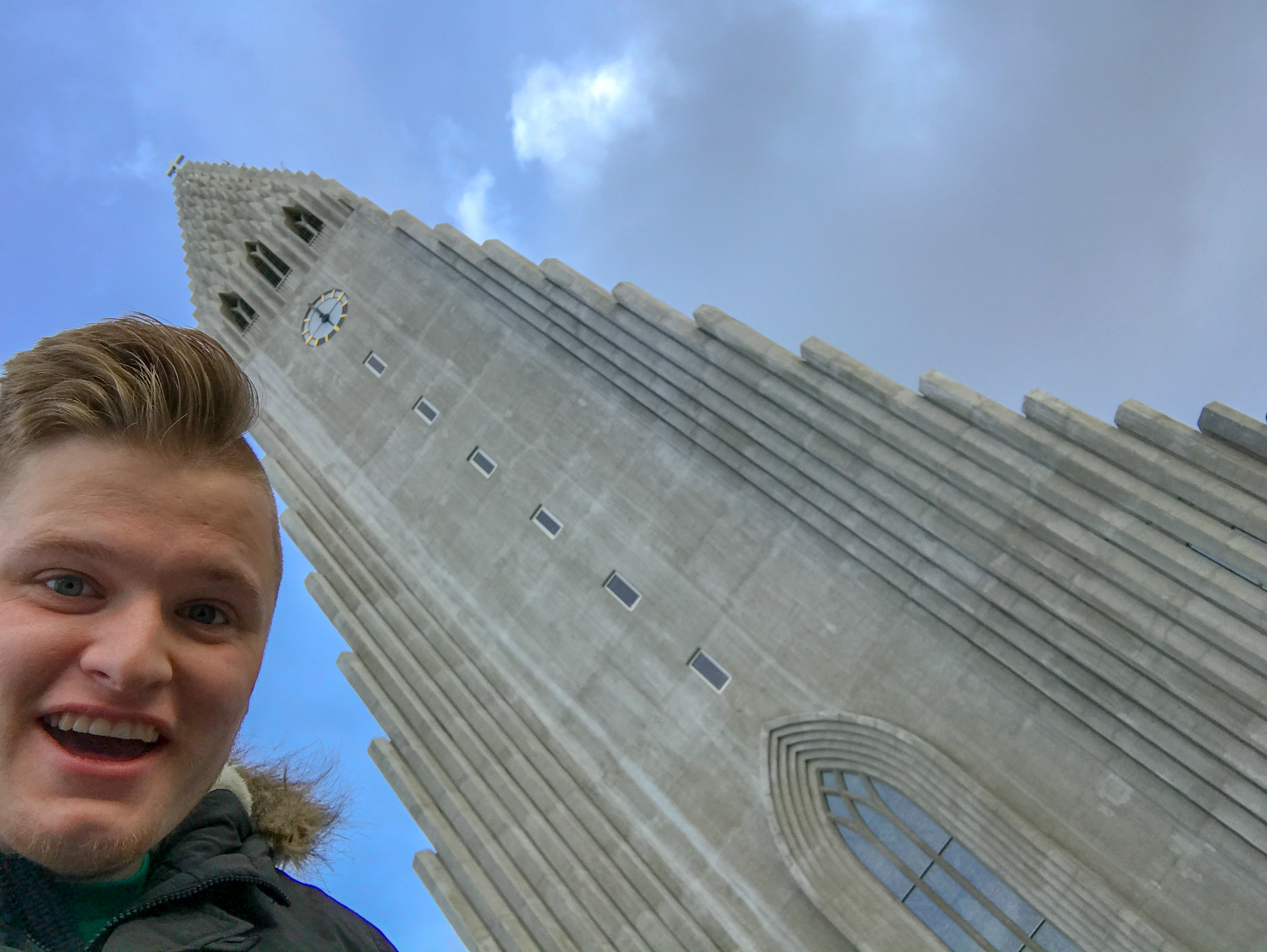 Hallgrimskirkja is hard to frame when taking a photo, so here's me snapping a selfie with it.