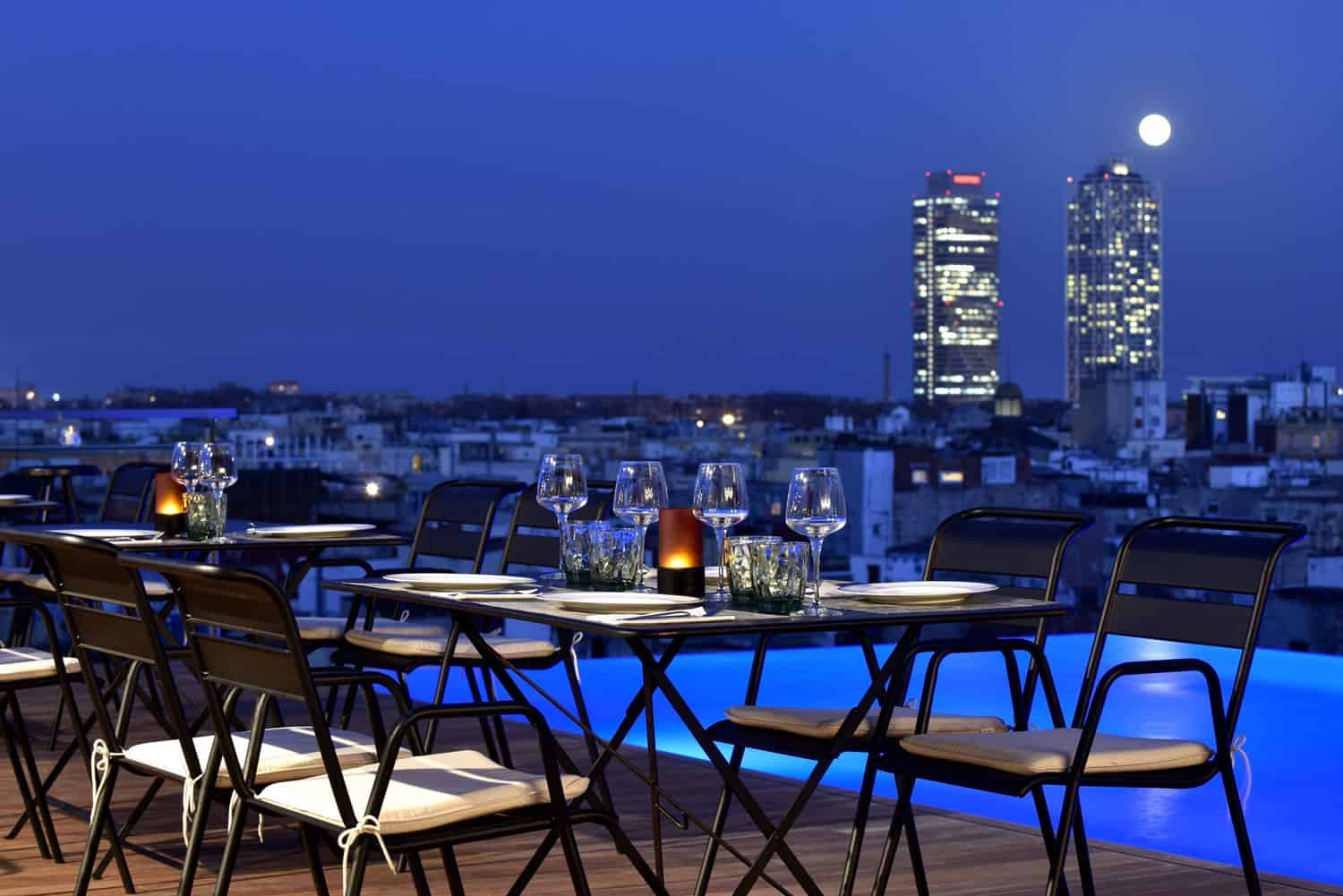 Enjoy a candlelit dinner as the sun goes down on Grand Hotel Central's rooftop terrace. Image credit:    Grand Hotel Central   /Fair Use