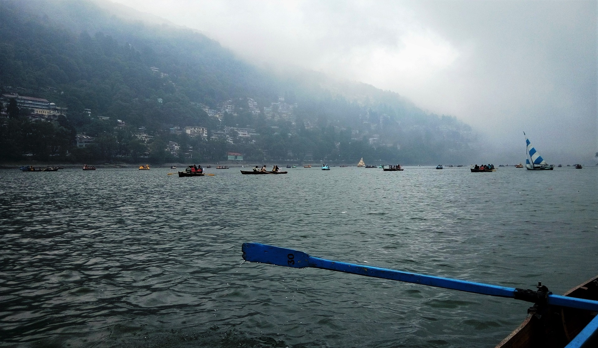 Try a spot of rowing on Nainital Lake.
