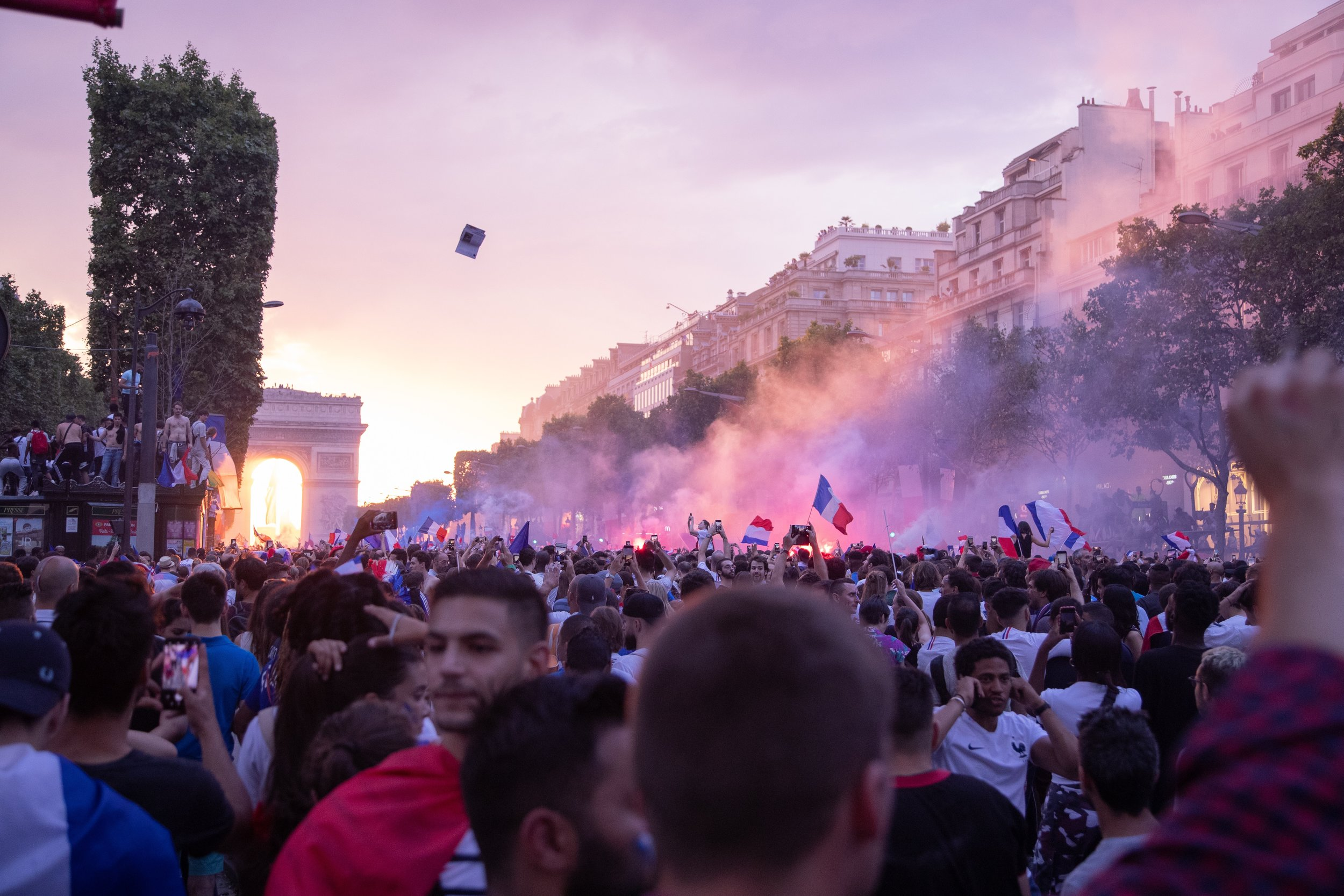 France fans celebrating the teams victory in the final of the 2018 FIFA World Cup along the Champs-Élysées in Paris.