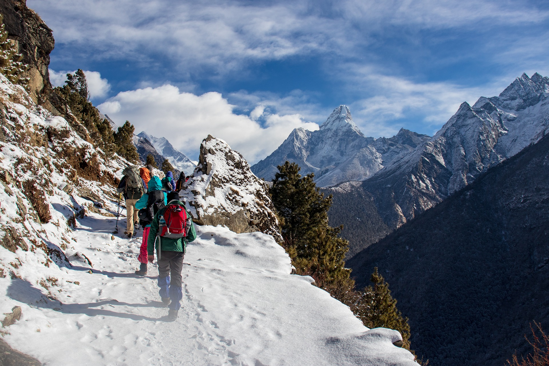 A group hiking in the Himalaya mountains in Nepal.