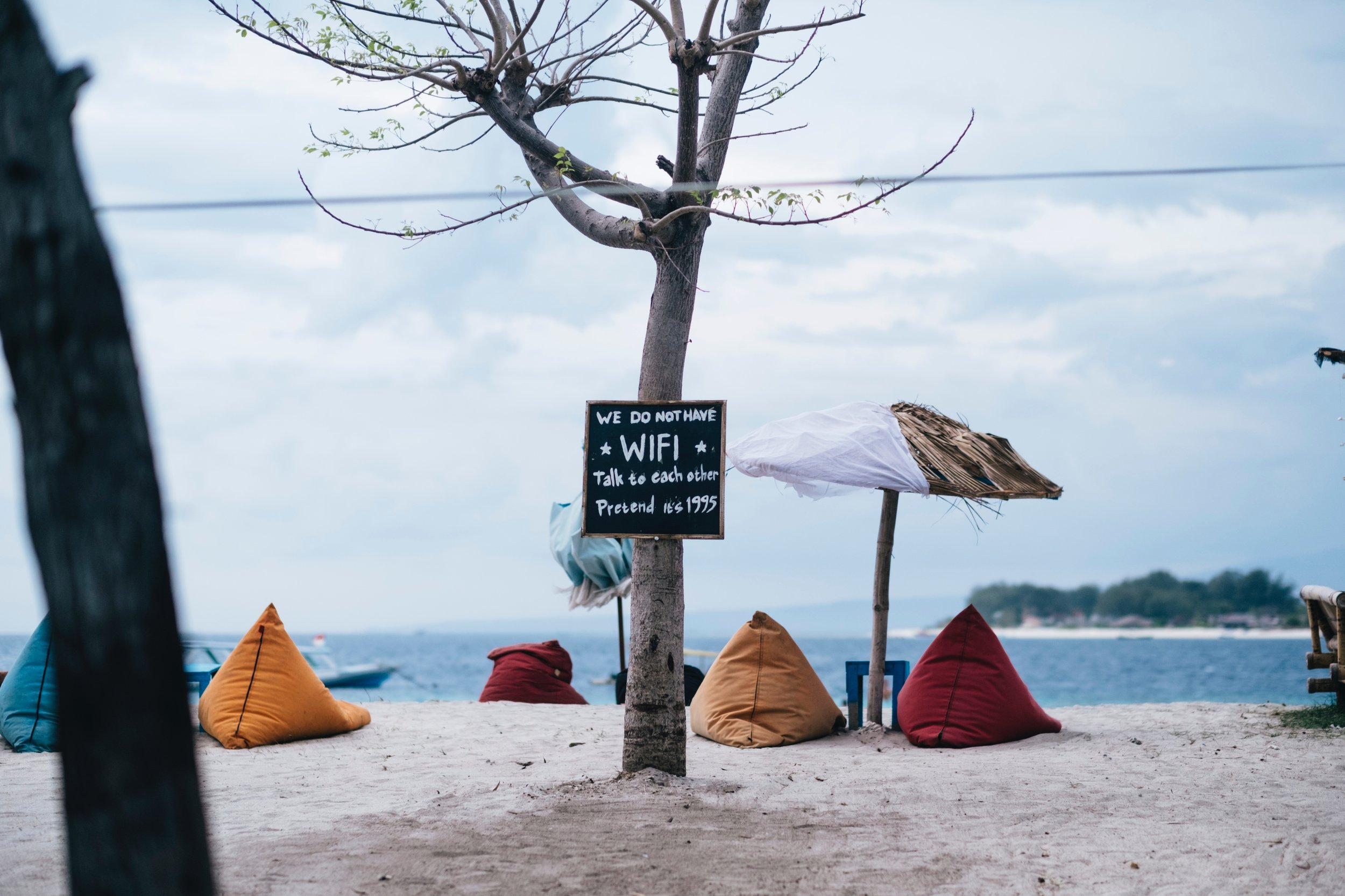 Beanbag chairs on the beach = cool. Hipster WiFi signs = lame.