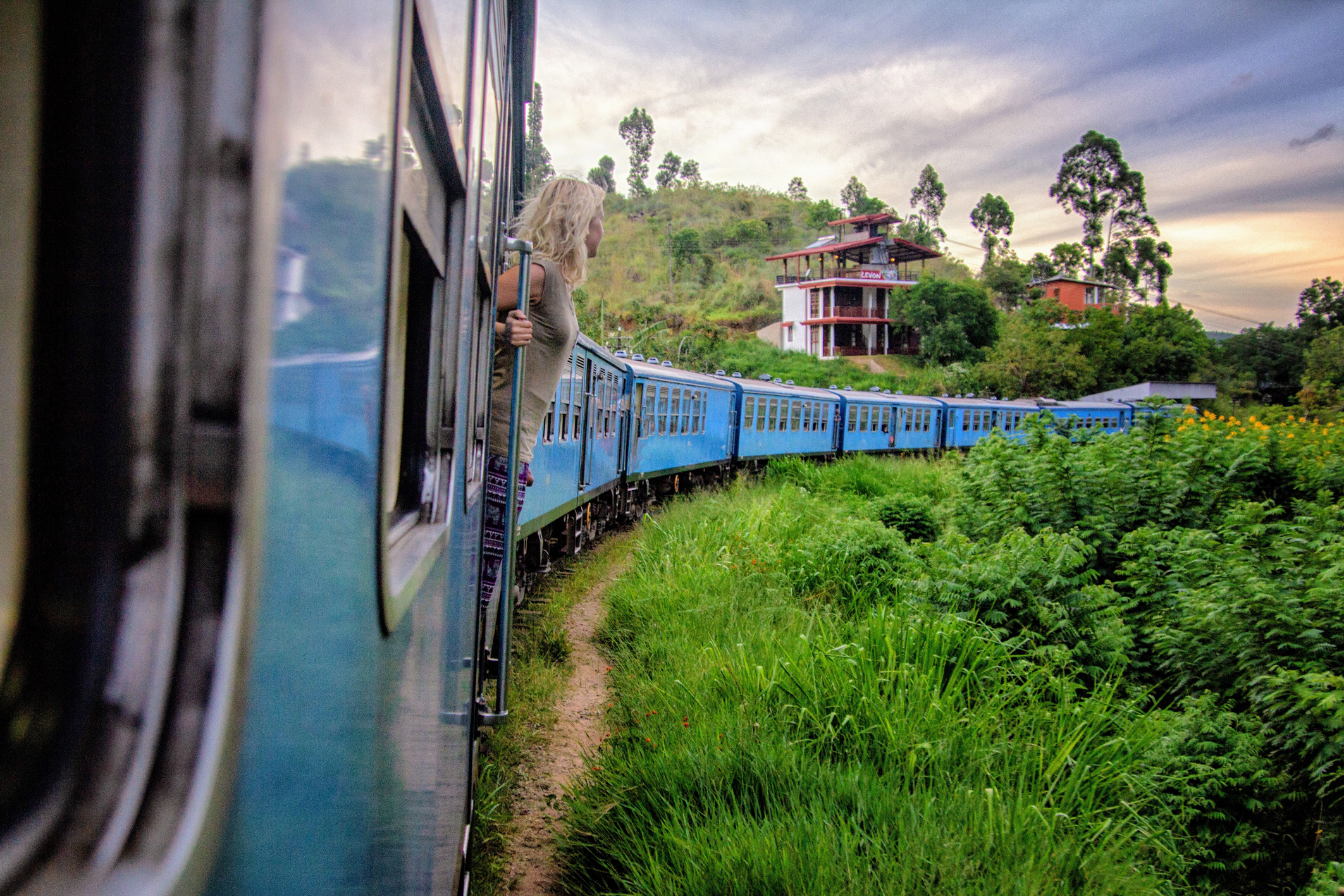 A girl getting the iconic shot on the train from Ella to Kandy in Sri Lanka.