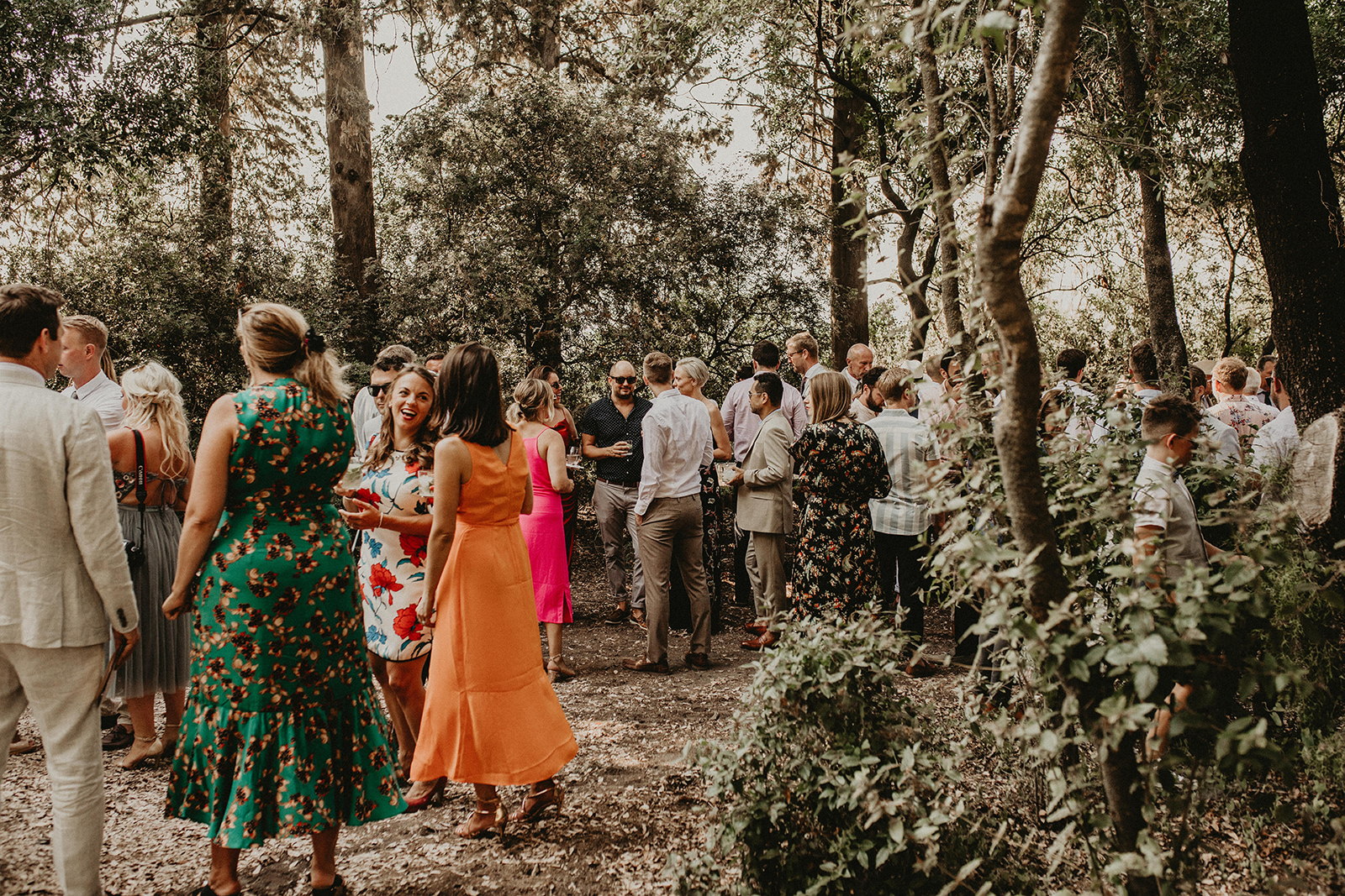 forest wedding guests having fun