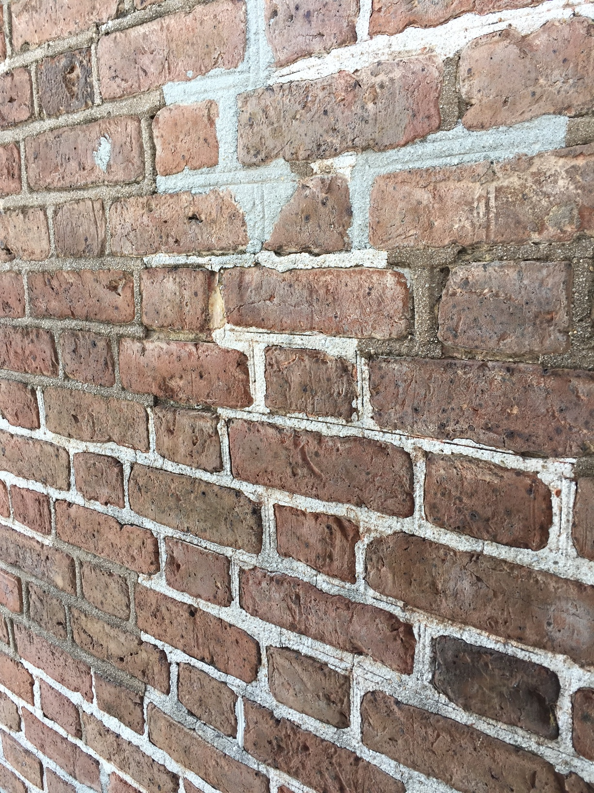 - May 8, 2017The bricks on the façade of 28 Broad Street date from the late 18th century. They are a lot weaker in compressive strength than today's bricks. When choosing mortars for repointing historic masonry it's important to choose a weak mortar that has a compressive strength less than the brick. A mortar that is too hard will cause the brick to spall, or chip away. The mortar we will use has more lime so it can be softer. The grey mortar is probably a Portland cement based mortar that is not appropriate for repointing brick of this age.