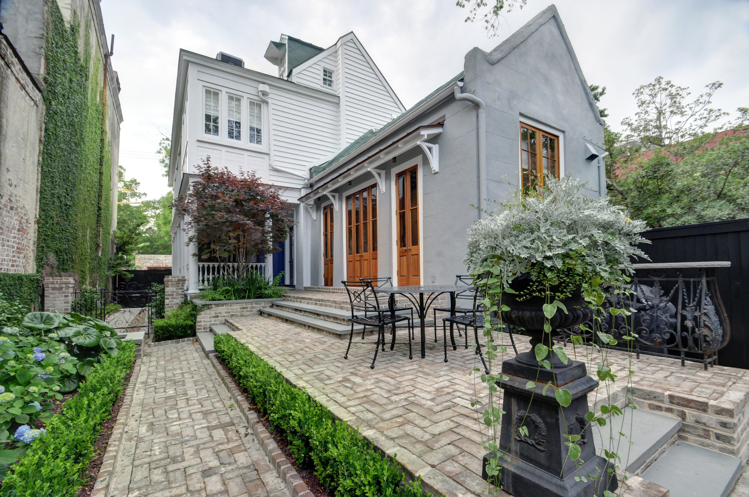 - May 15, 2017This renovation at 41 Society Street involved the re-imagining of a kitchen house and its relationship to the garden. The raised patio works as an extension of the piazza and the kitchen, tying the two together. The team at Wertimer + Cline Landscape Architects did a wonderful job with this garden landscape. The owner's vision made this project a successful design collaboration. More to come soon on the website.