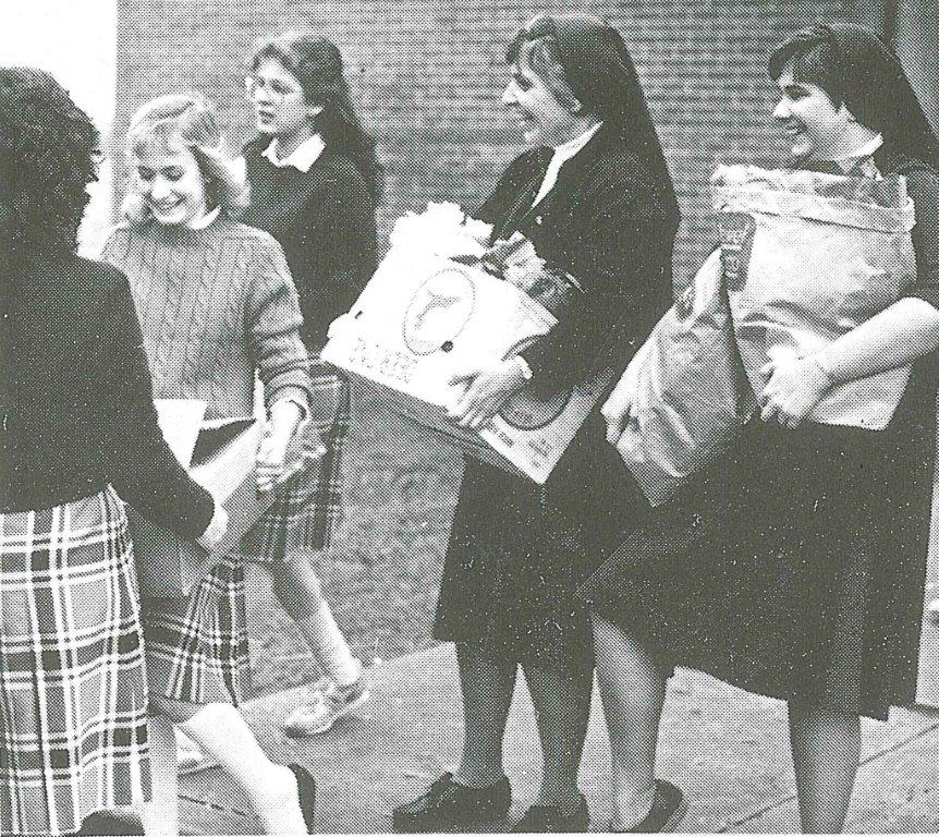 1984 MHS freshmen Cherie Dinkleman and Susie Petersen. Sister James Jeffers and Sr Mary Beth Kubera loard truck for Marillac House.jpg