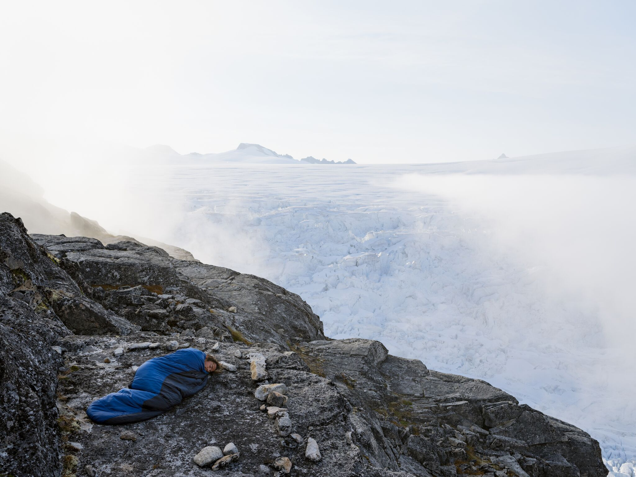 Evan Sleeping at Camp 18, Juneau Icefield Research Program, Alaska 2016    If climate-warming trends continue, the Juneau Icefield is expected to completely disappear by 2200.