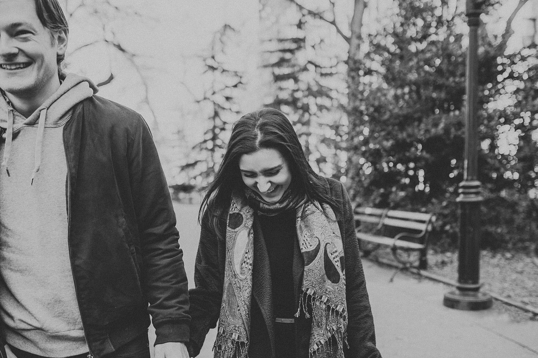 Candid and fun walk around Washington Square Park during engagement session in New York City, New York