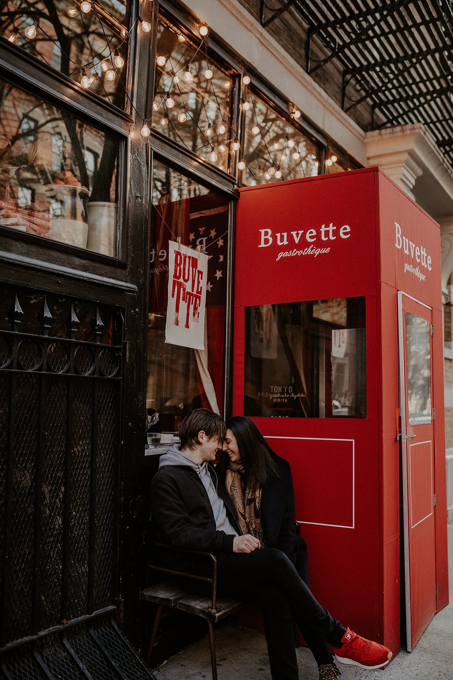 Couple sitting at Buvette during engagement session in New York City, New York