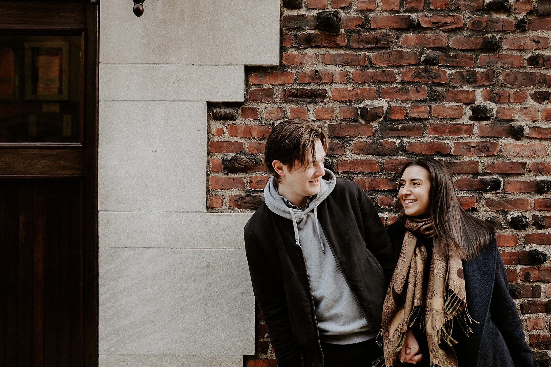 Couple laughing and dancing while having fun during engagement session in New York City, New York
