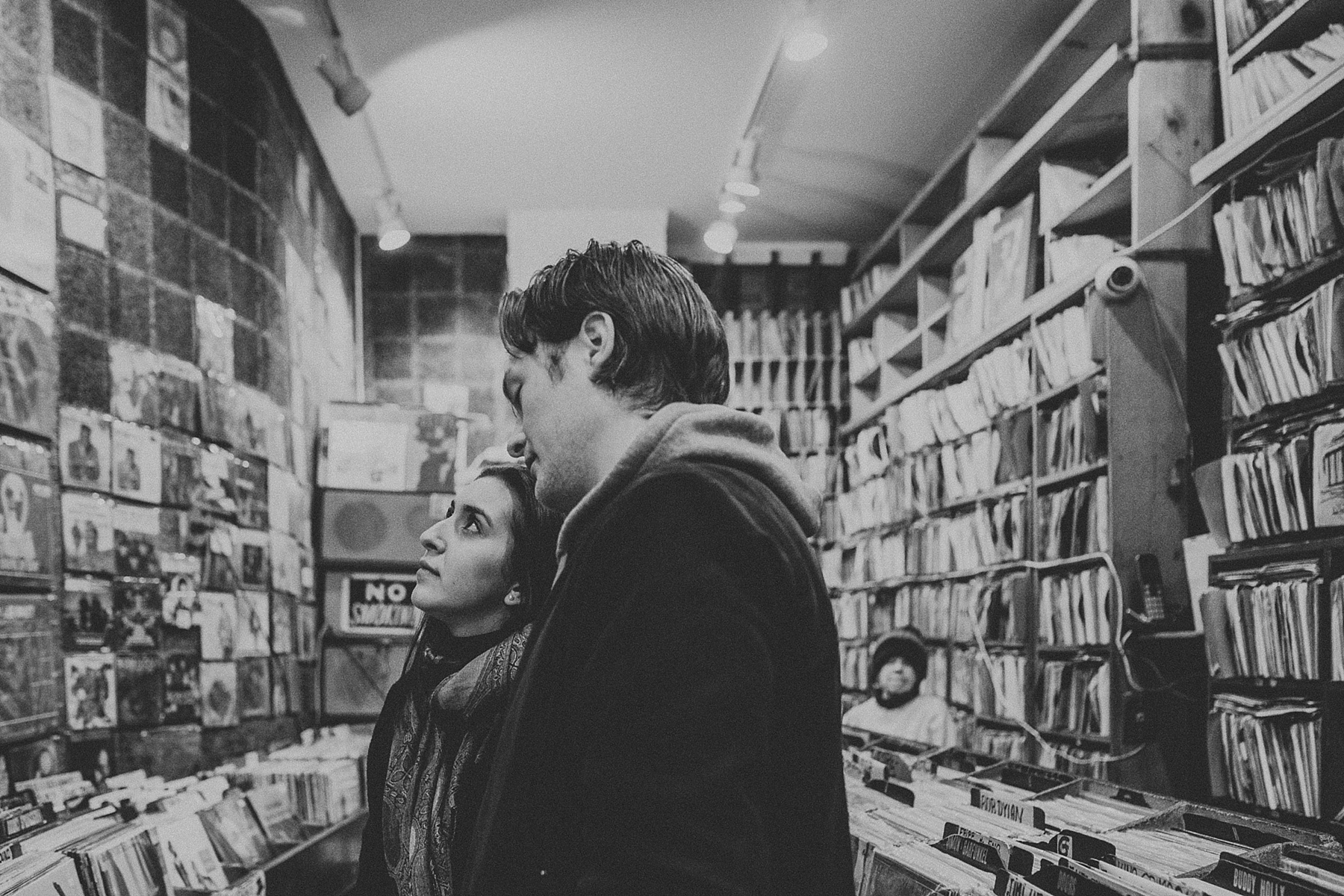 Couple hanging out in record store and shopping for vinyls during engagement session in Greenwich Village, New York City, New York