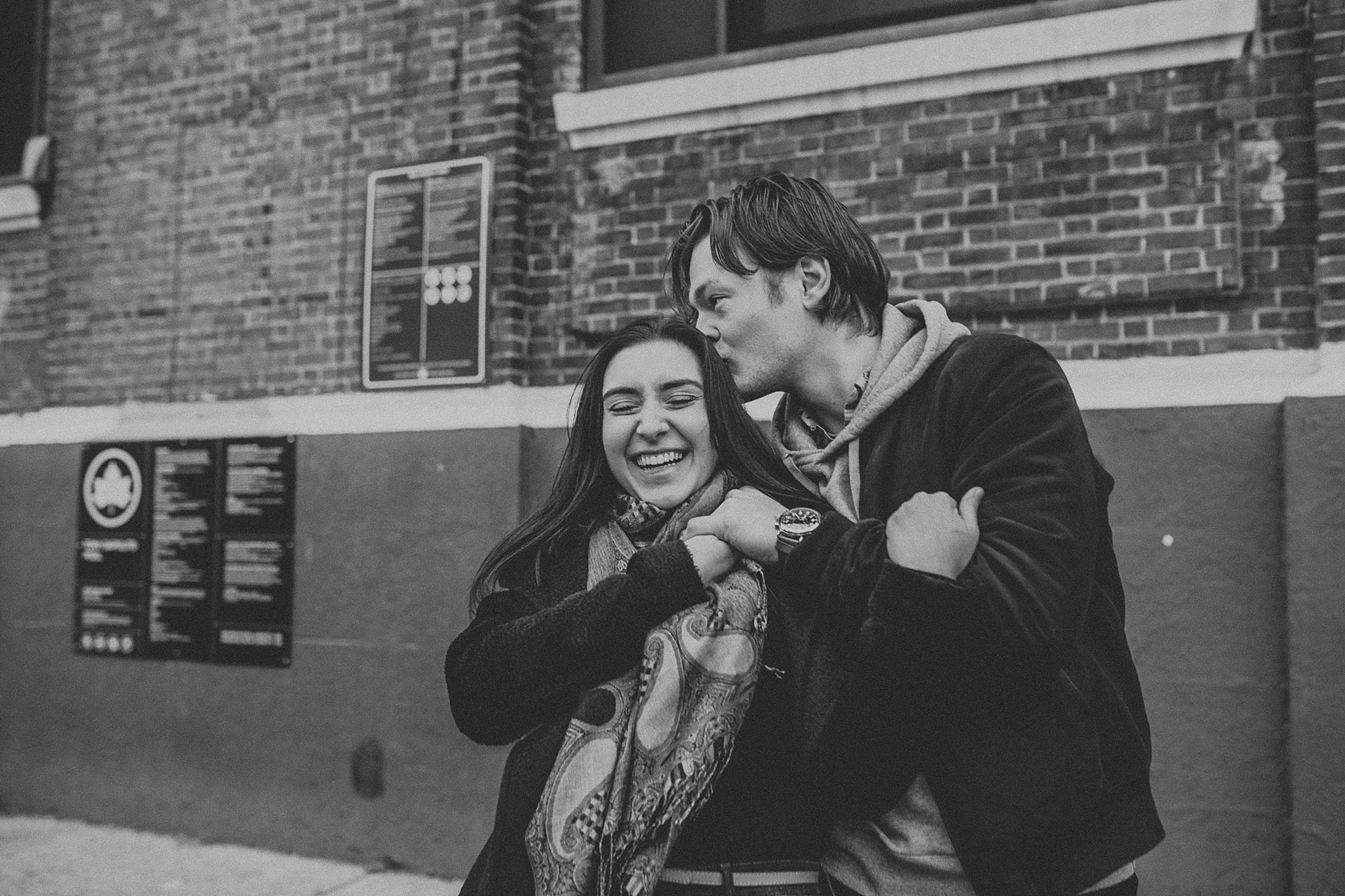 Couple hugging while having fun during engagement session in New York City, New York