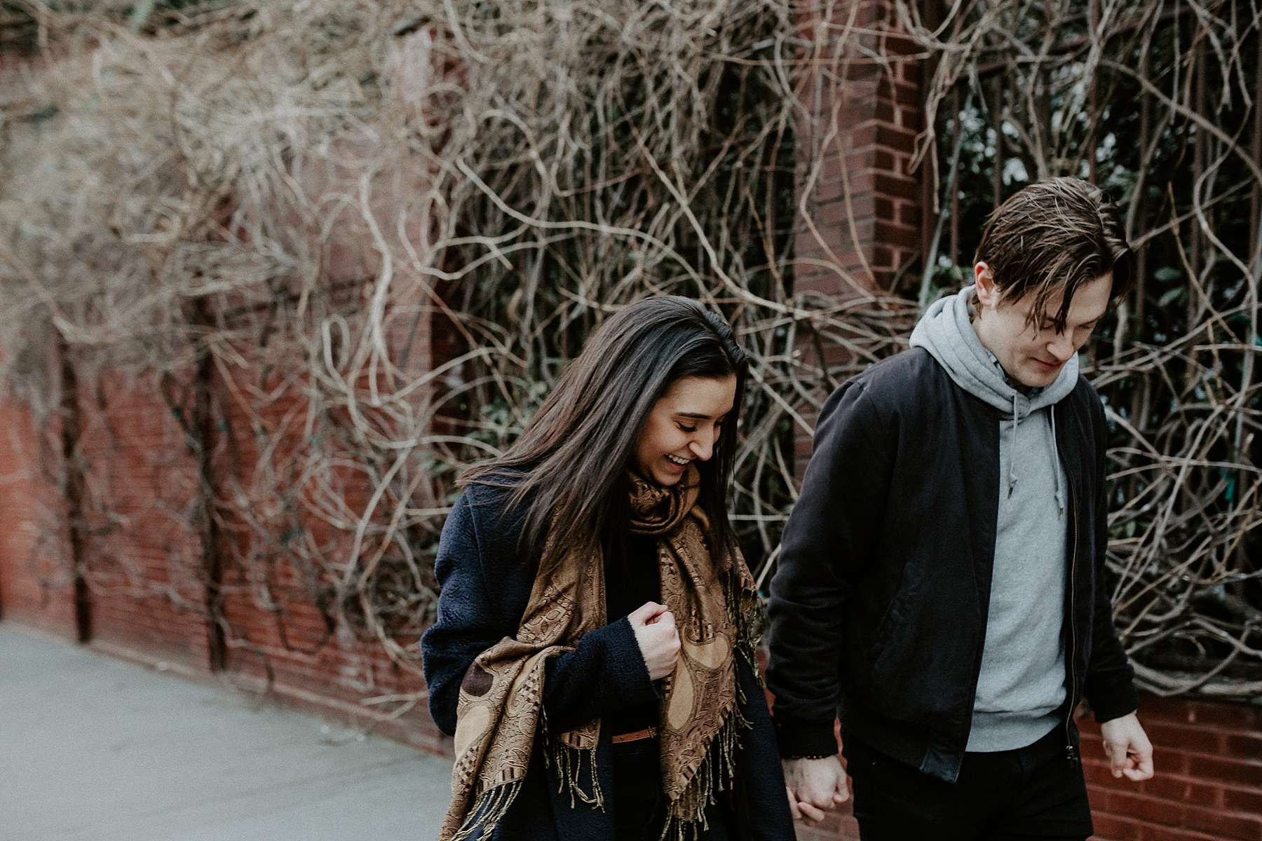 Dancing and frolicking while holding hands during engagement session in New York City