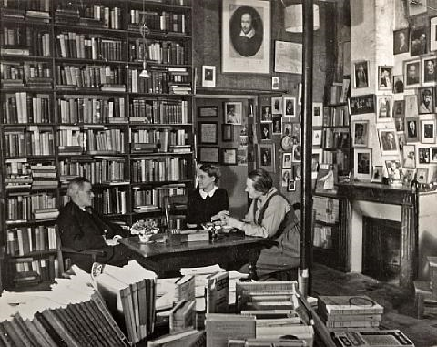 James Joyce, Sylvia Beach, and her partner Adrienne Monnier inside Shakespeare and Company.