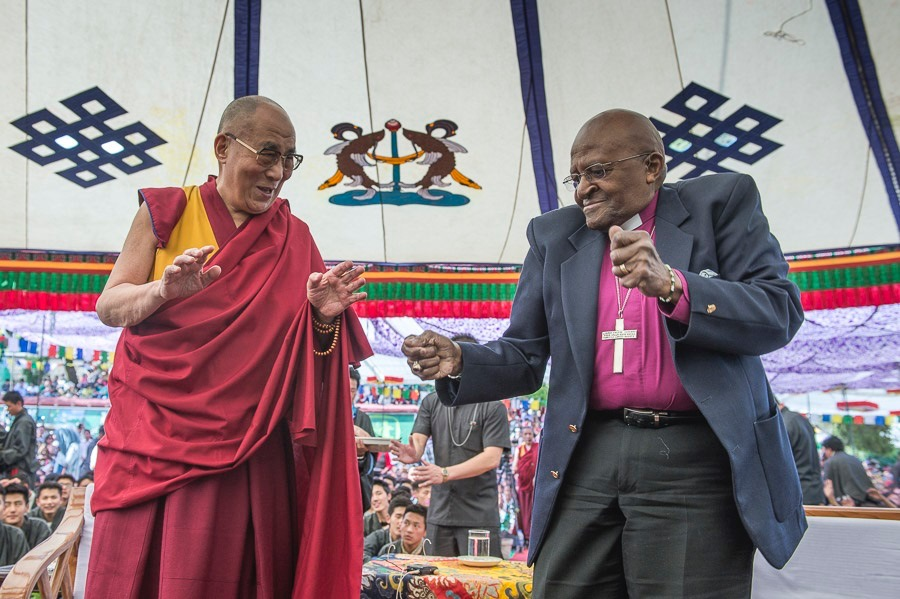 The Dalai Lama and Archbishop Desmond Tutu shake their booties.