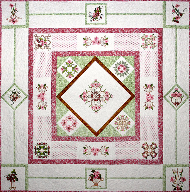 Cherry Blossoms Quilt Pattern - Pattern for quilt featuring Mylar Cherry Blossoms embroidery design collection from Purely Gates. This pattern will work with most any embroidery design collection. Finished size is 58