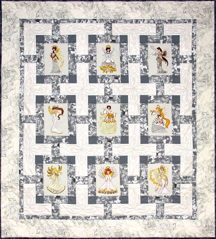 Heavenly Angels Quilt Pattern - Pattern for quilt featuring Mylar Heavenly Angels embroidery design collection from Purely Gates. This pattern will work with most any embroidery design collection. Finished size is 53