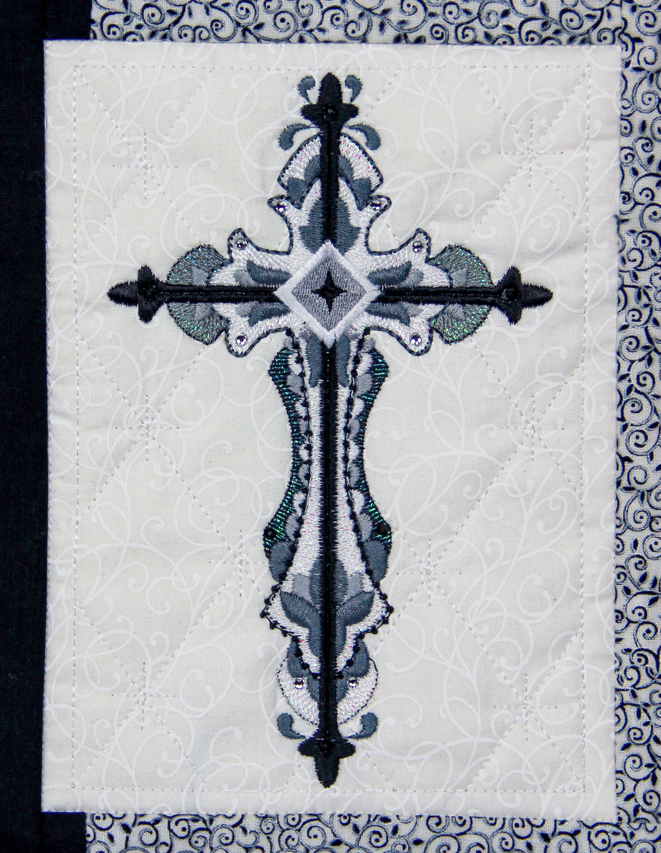 Quilting Motif behind design, Cross design not included.