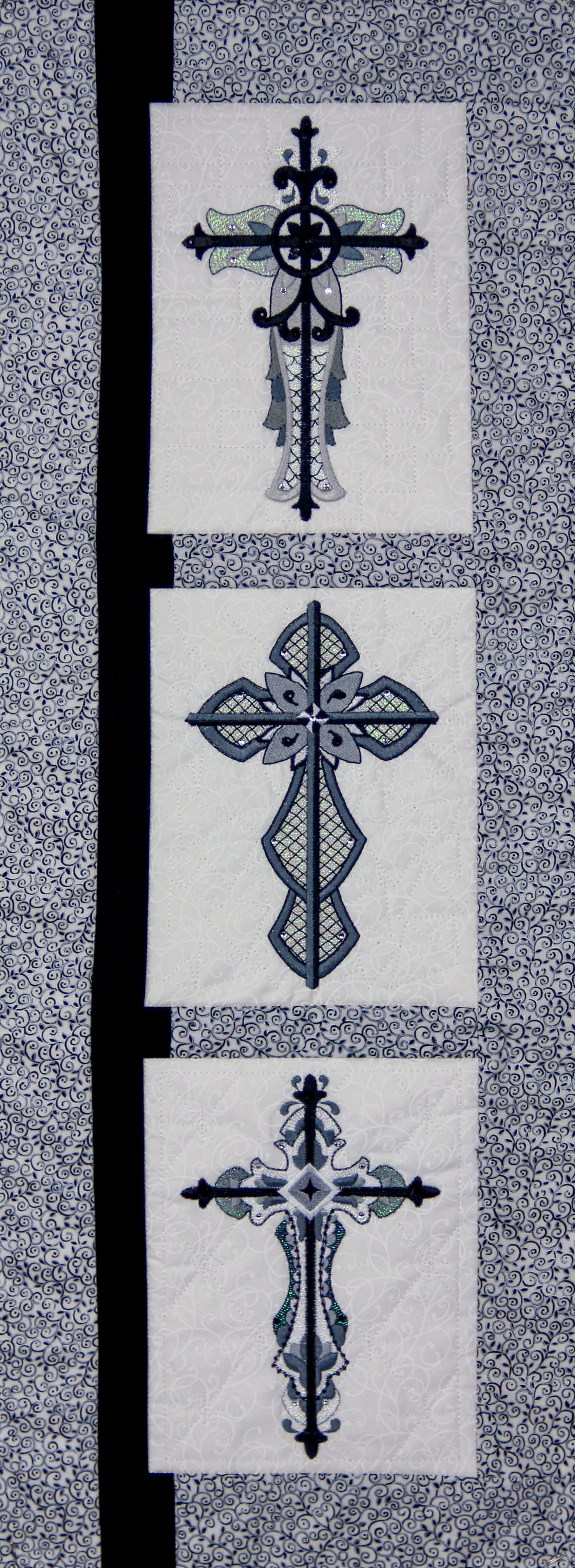 Quilting Motif behind design, Cross designs not included.