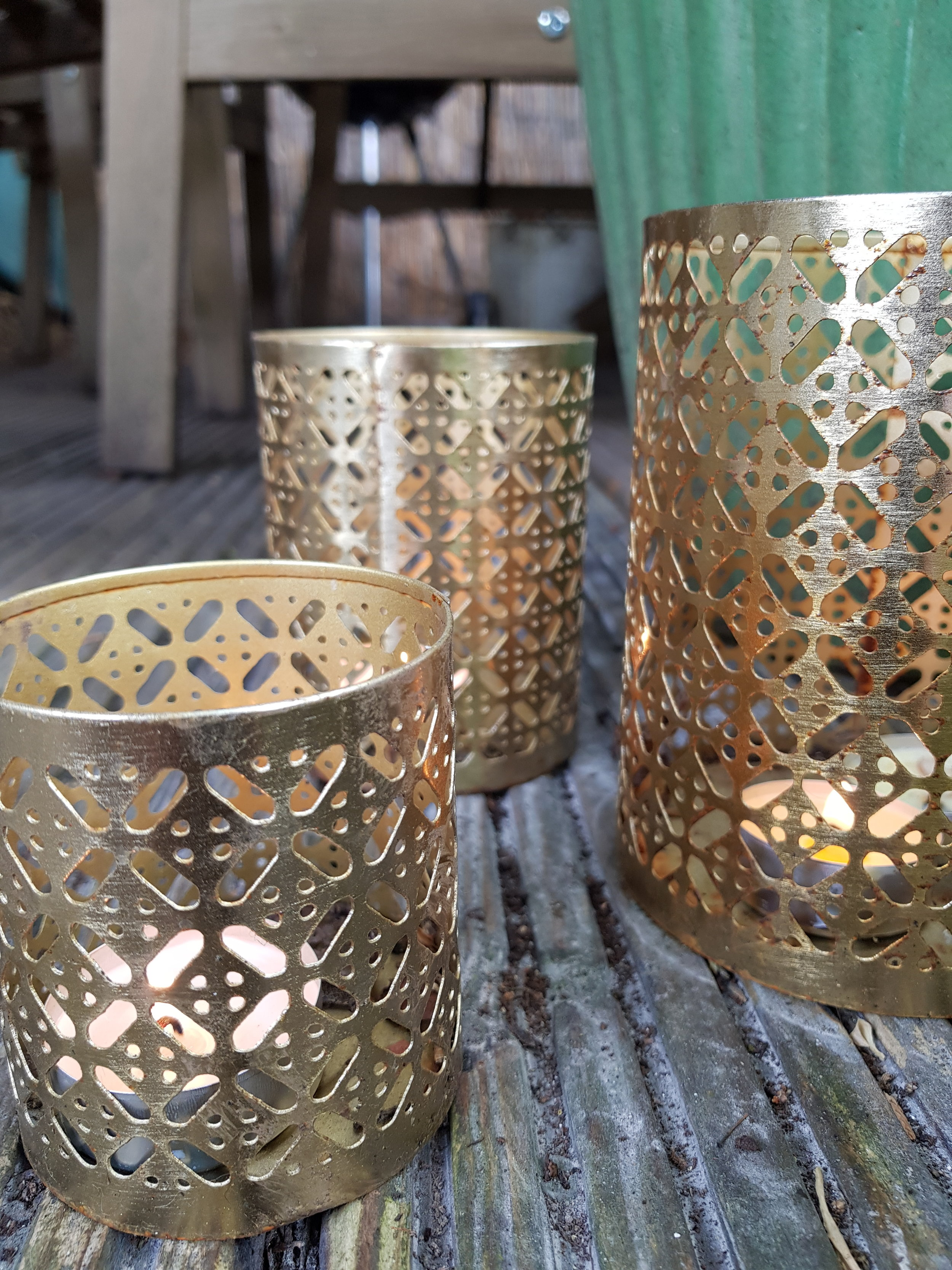 Inexpensive hurricane lamps and tea light holders can bring ambience to eating areas
