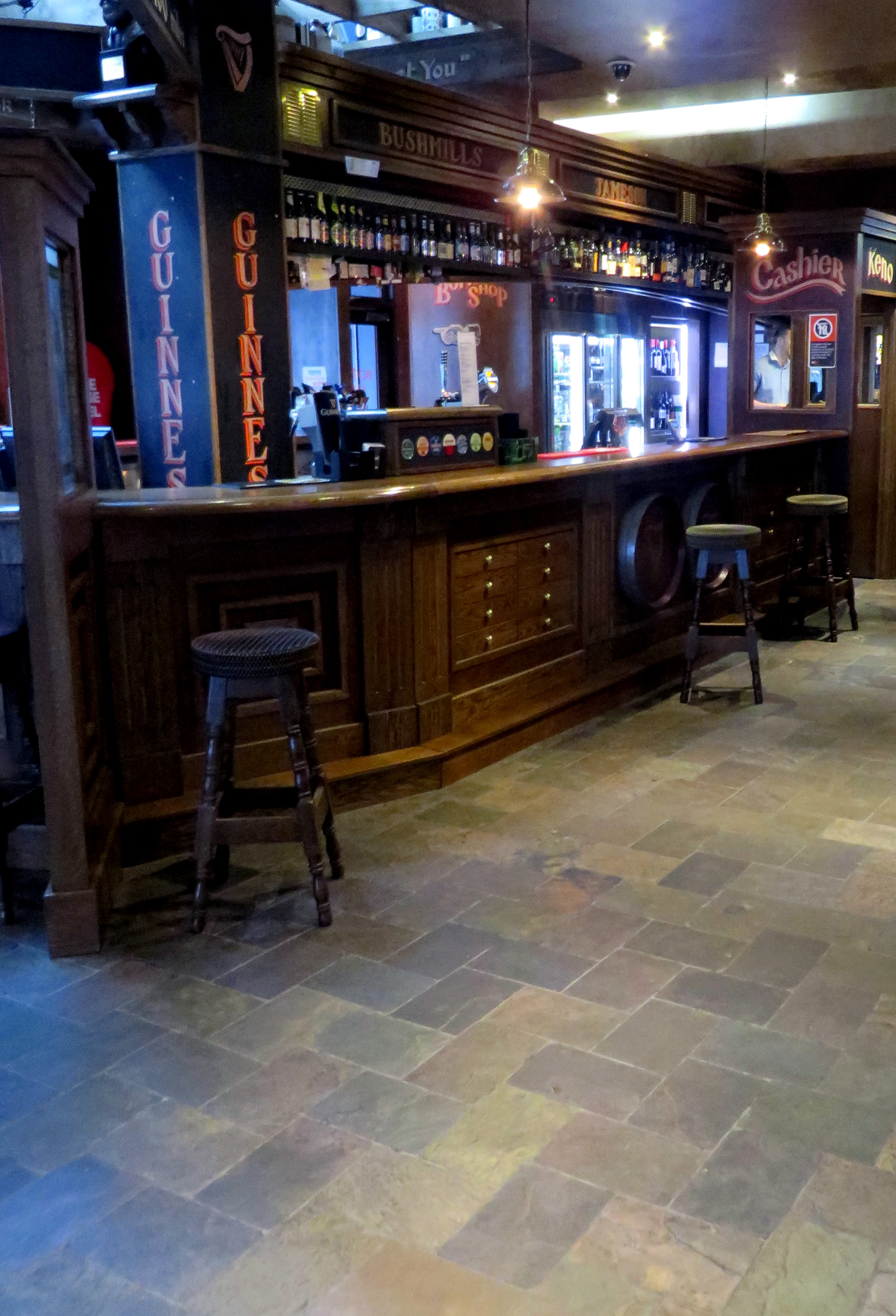 Unsealed Rajah slate on the floor of the bar
