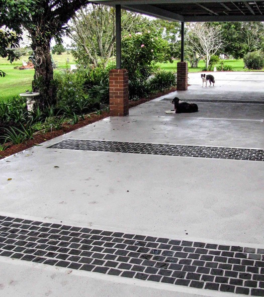 Cobble feature strips in country driveway