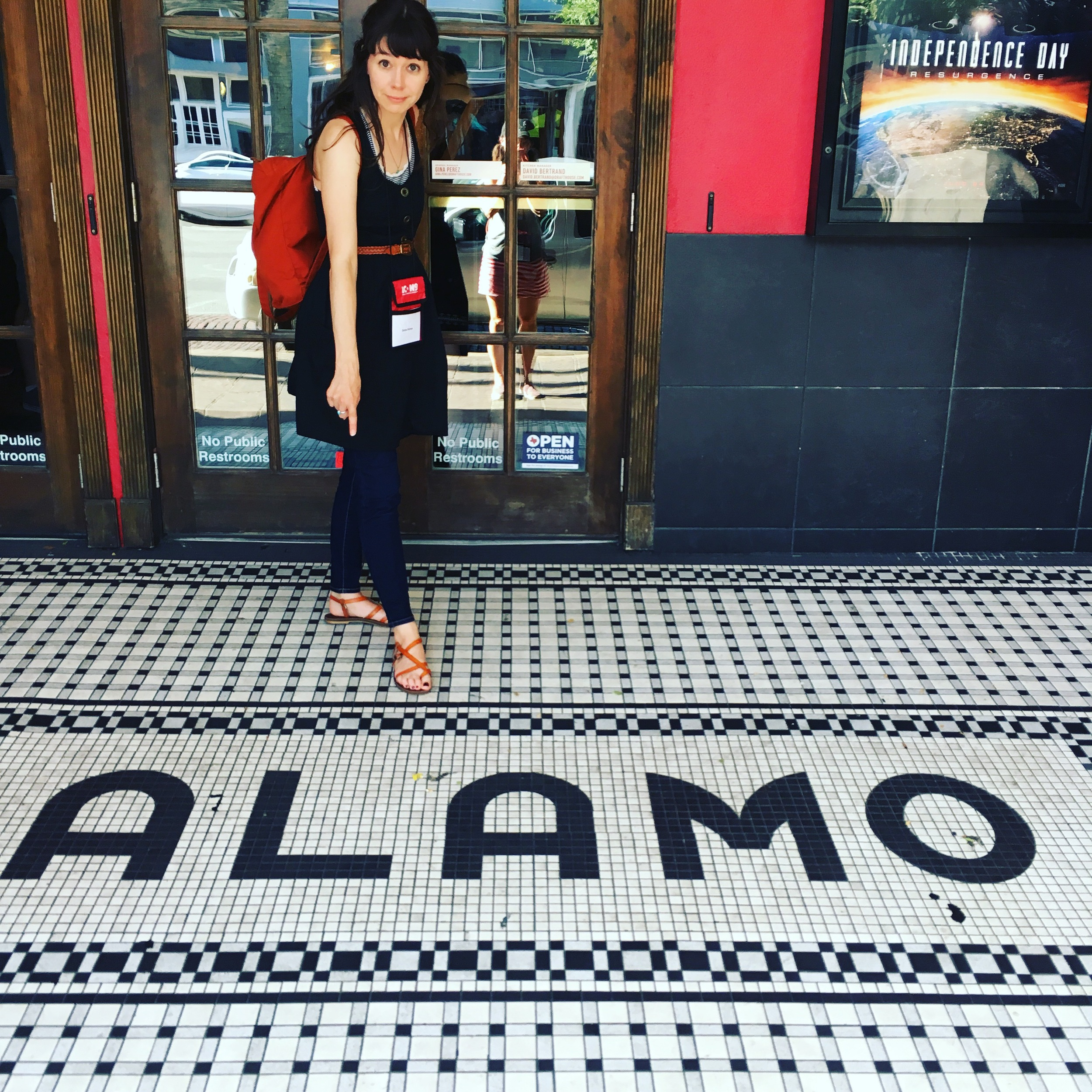 Denise pointing out the cool tile work at the entrance to the Alamo Drafthouse Cinema.