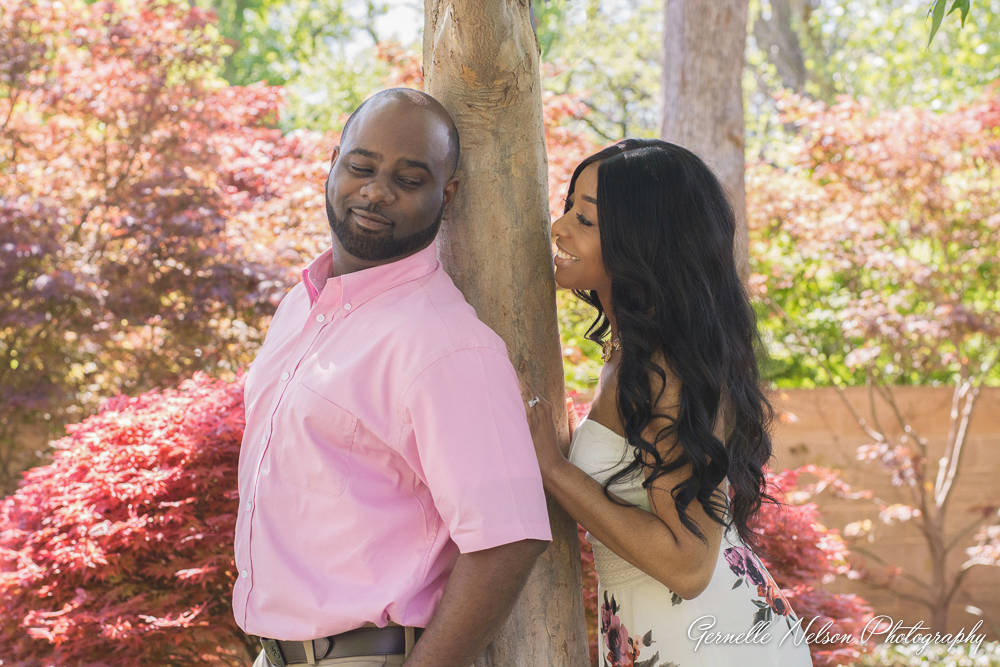 Pink and white engagement photo at the Dallas Arboretum by Gernelle Nelson, Dallas Wedding Photographer