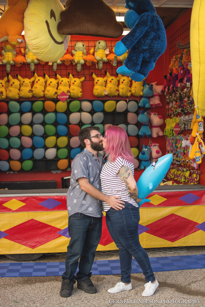 Engagement photos at the carnival in Fort Worth, TX by Dallas Wedding Photographer Gernelle Nelson
