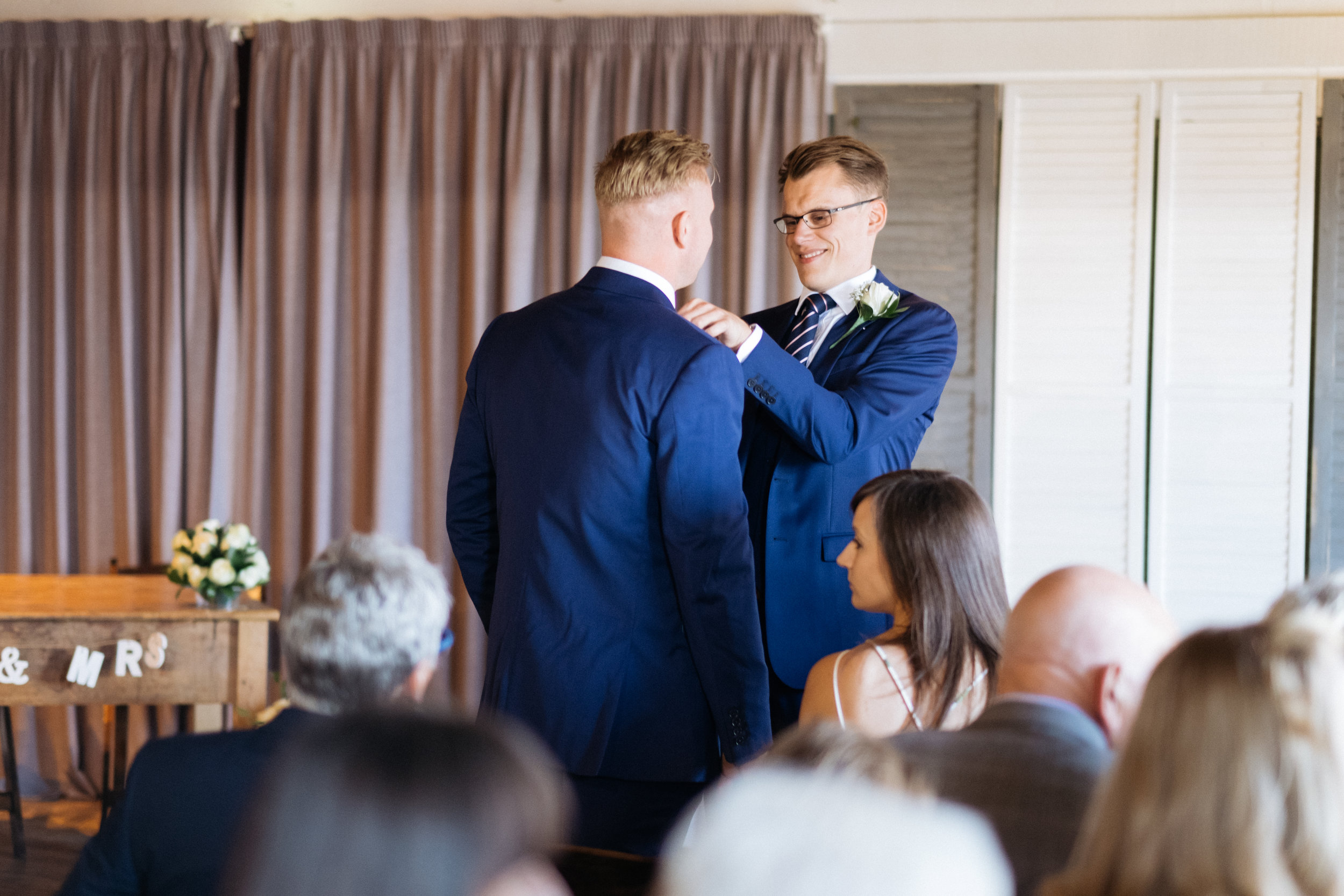 Groom and best man at East Quay wedding
