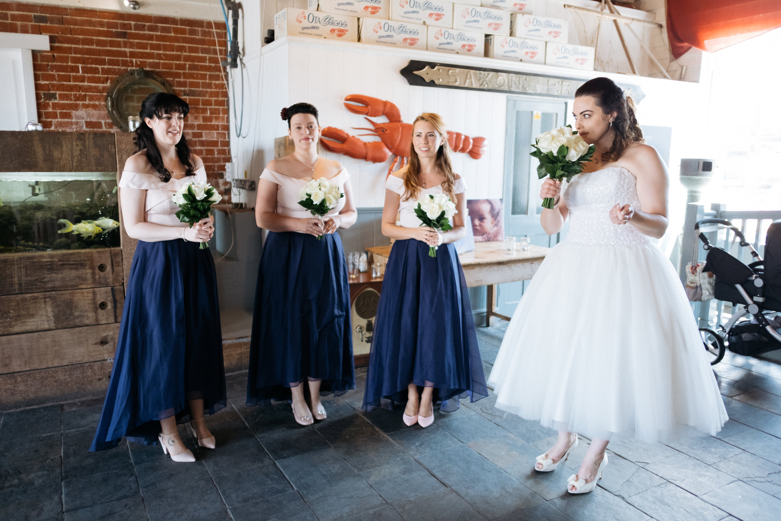 Bride and bridesmaids at East Quay wedding
