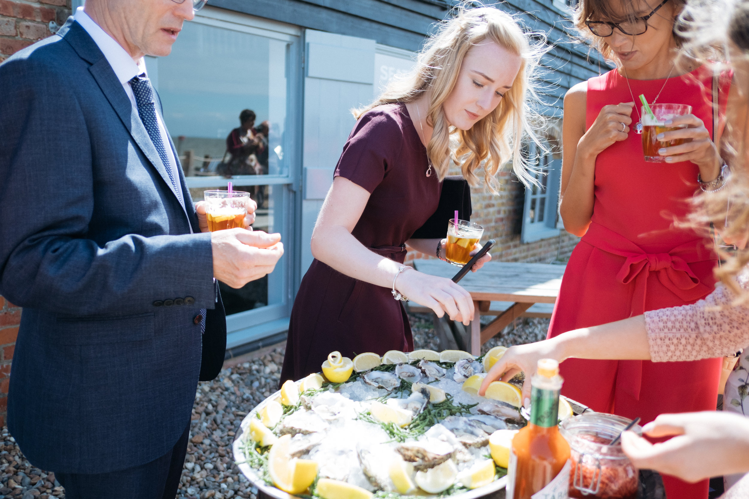 Guests eating food at East Quay wedding