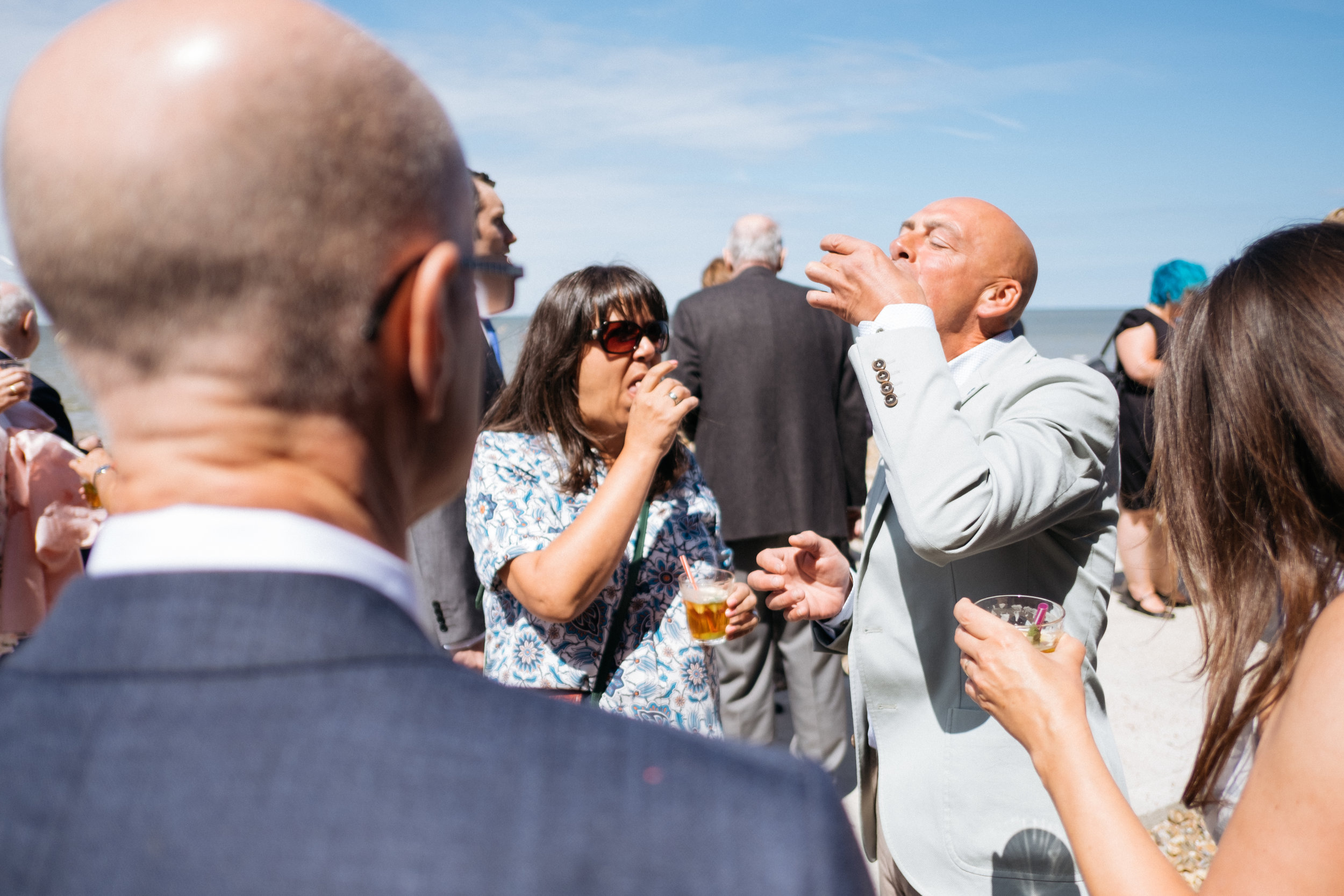 Guests eating oysters at East Quay wedding
