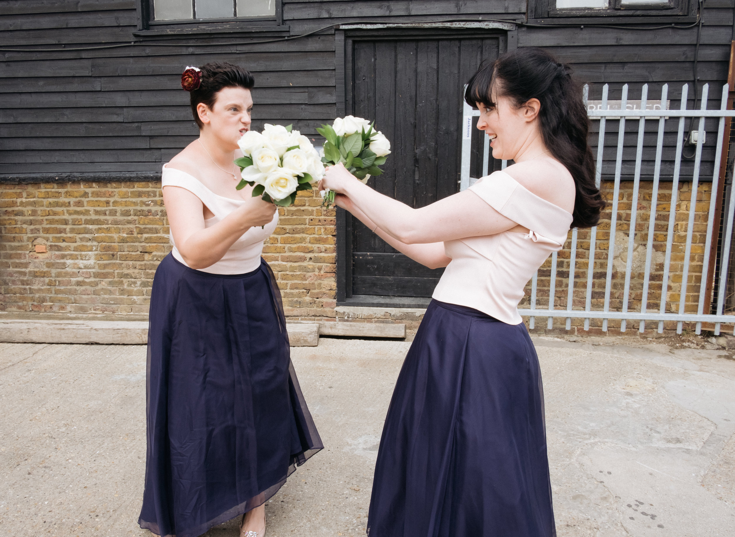 Bridesmaids having fun at East Quay wedding