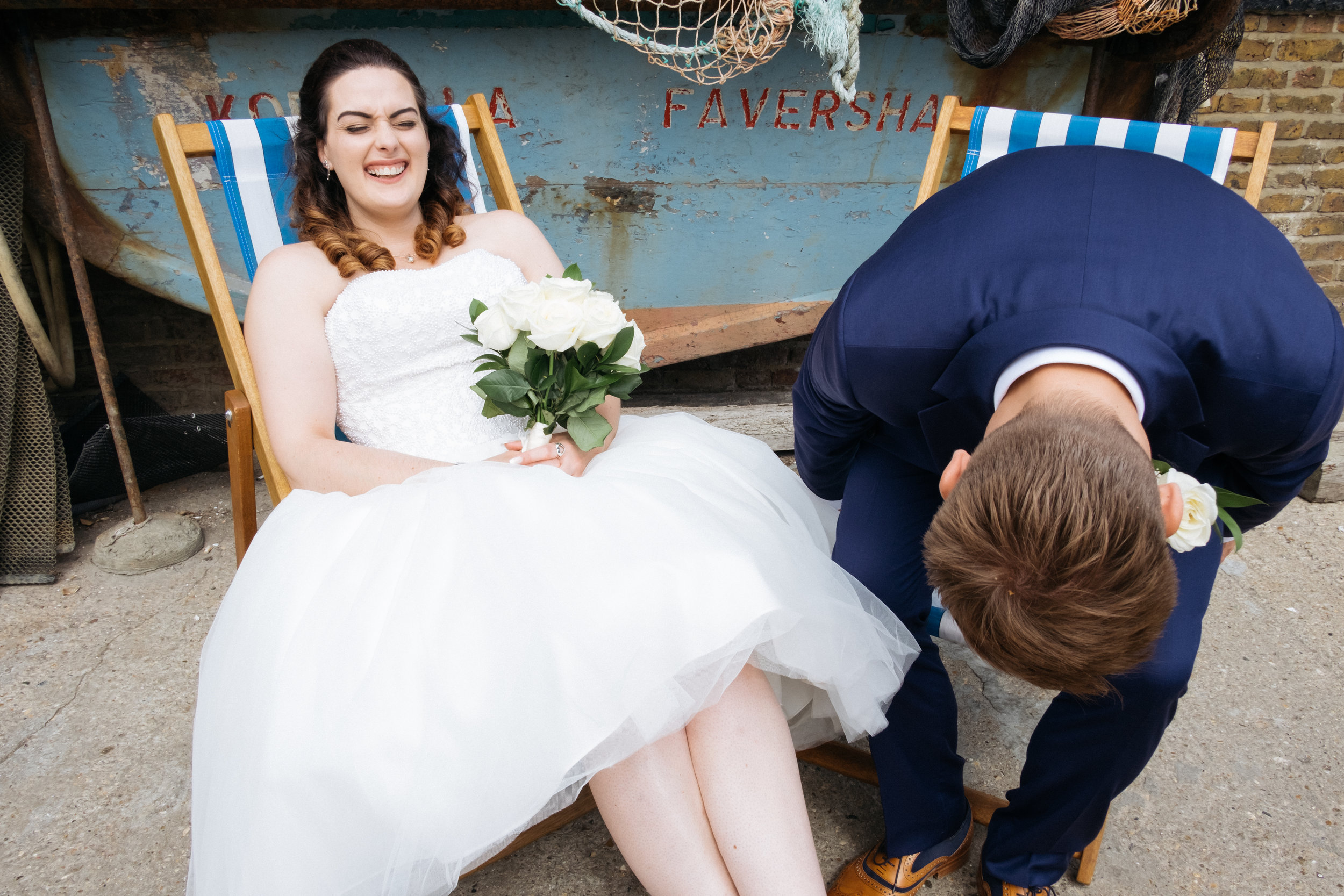 Bride and groom laughing at East Quay wedding