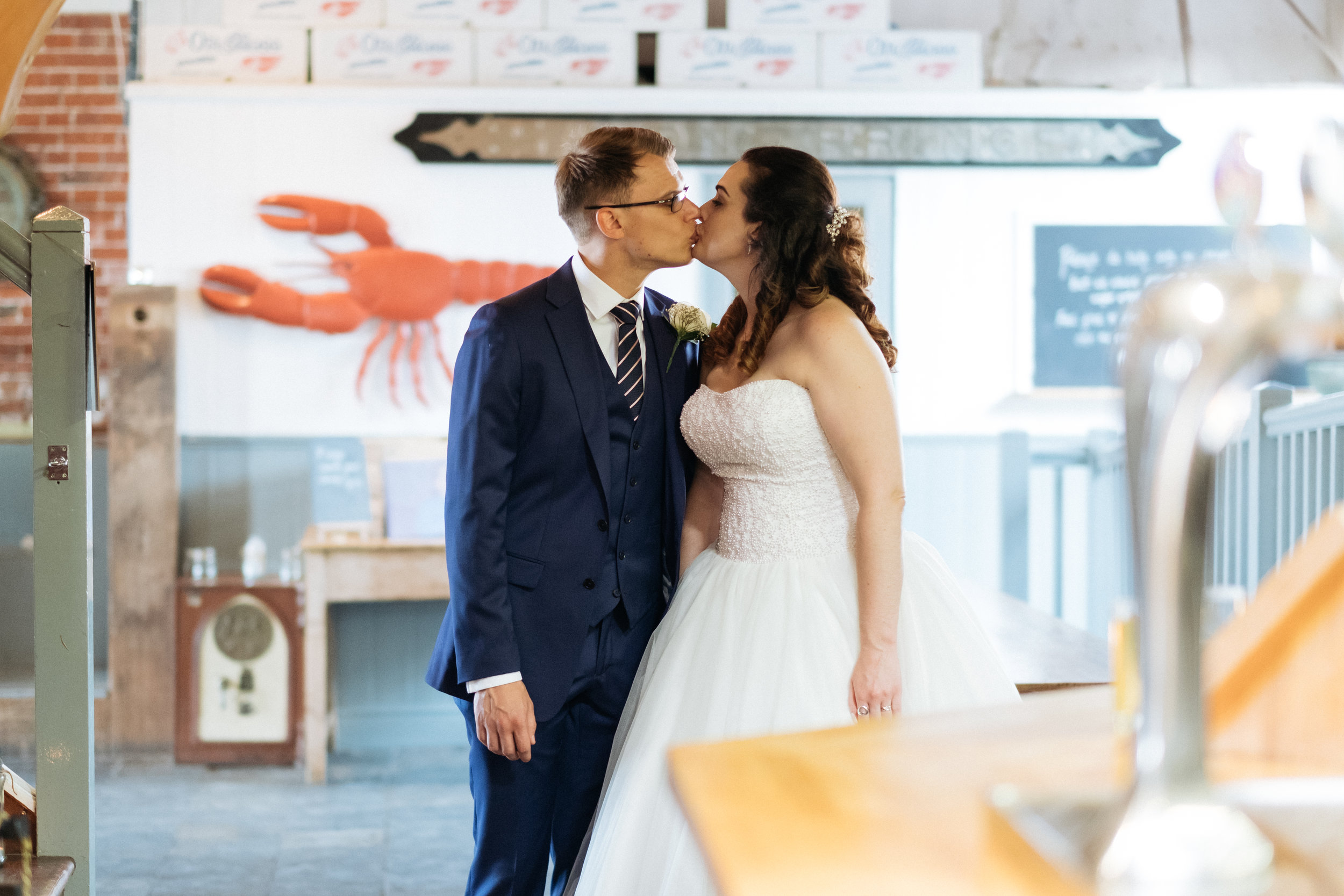 Bride and groom kissing at East Quay wedding