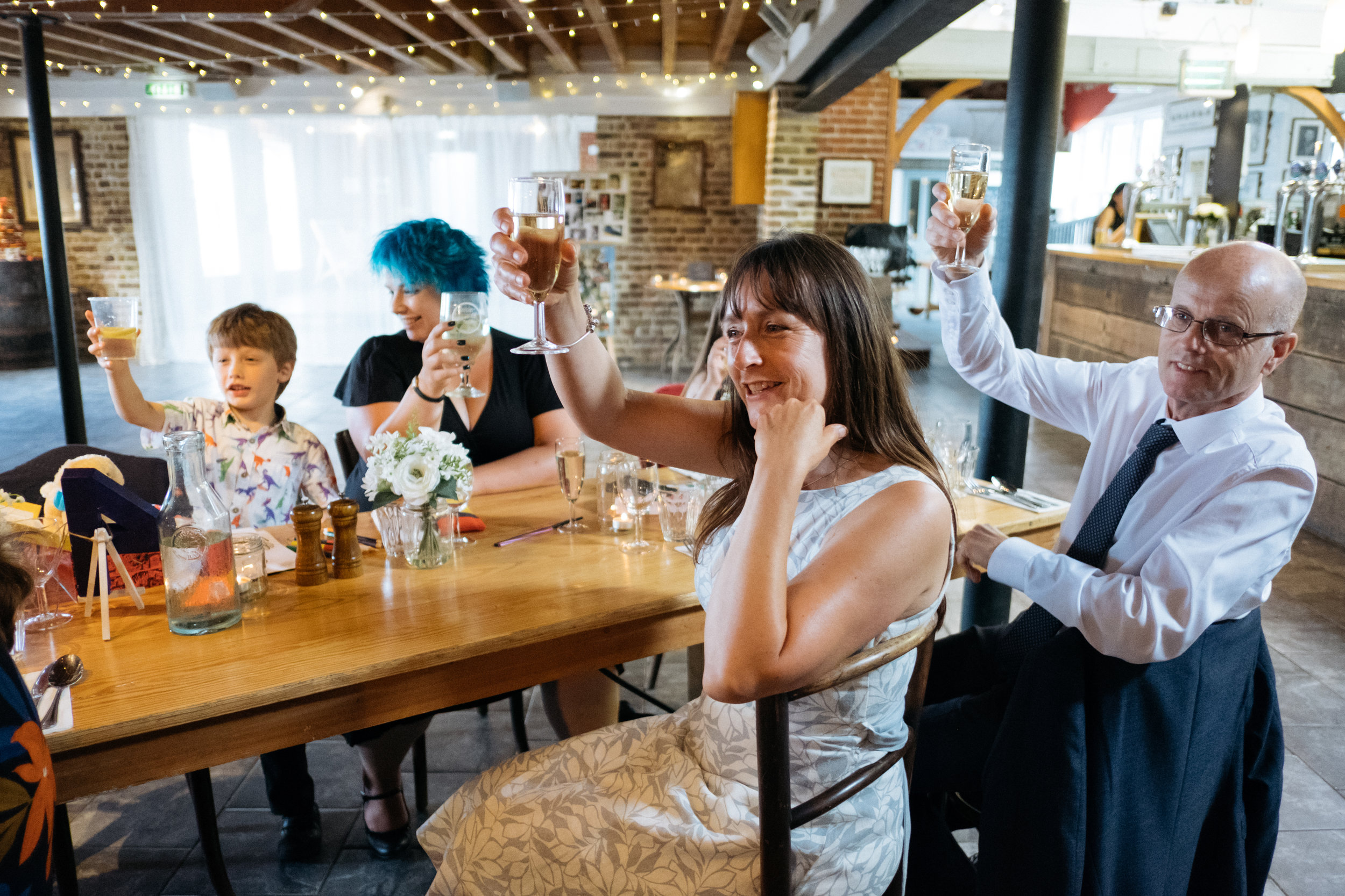 Raising a glass to the bride and groom at East Quay wedding venue