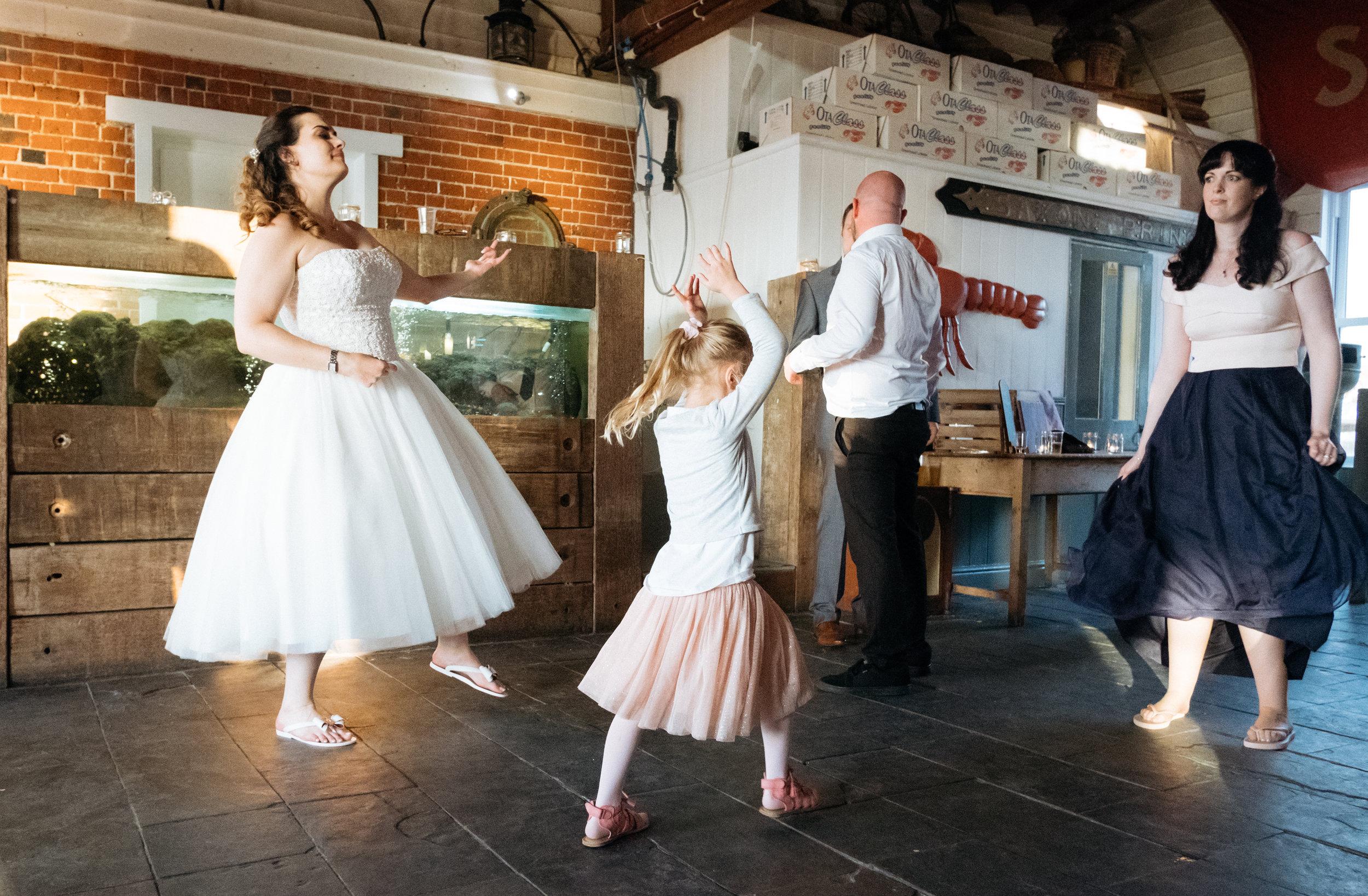 Air guitar dancing at East Quay wedding venue