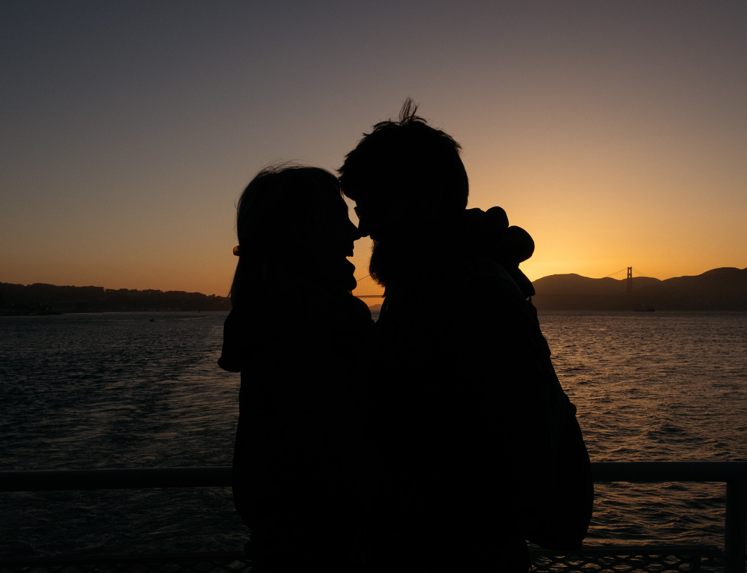 Couple silhouette at sunset with Golden Gate Bridge in background