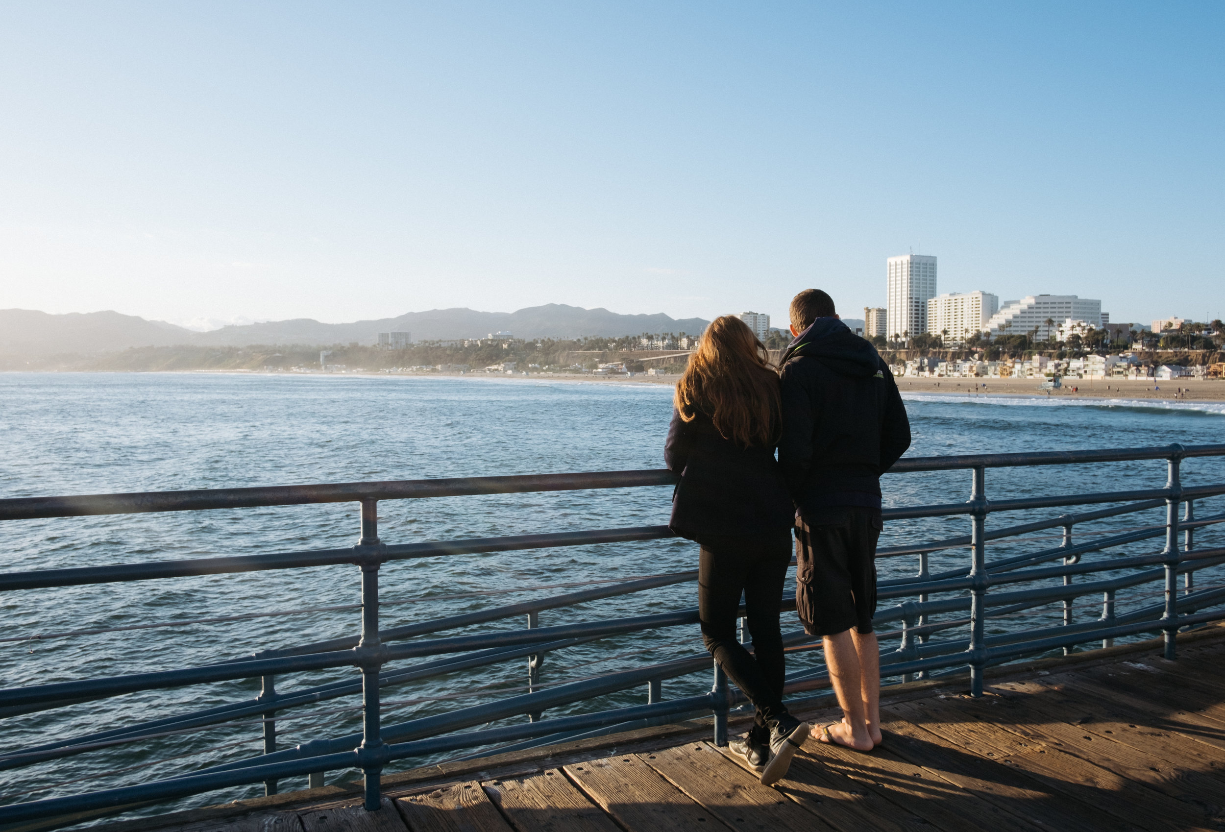 Couple standing on Santa Monica pier