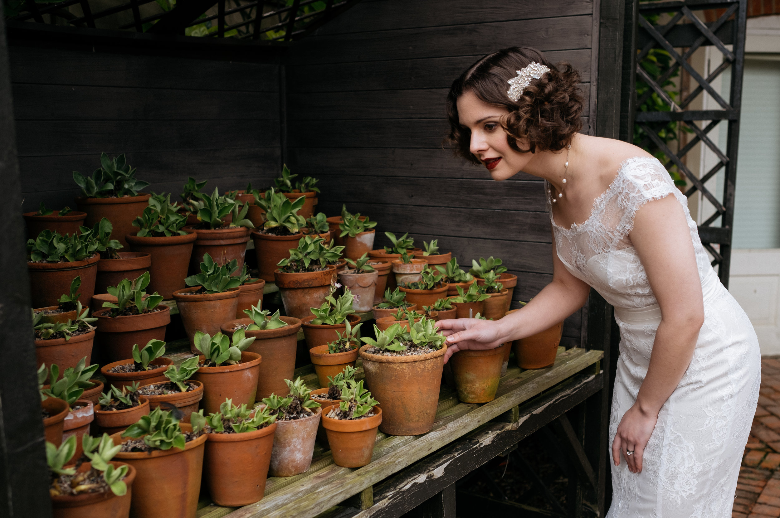 Bride looking at succulents