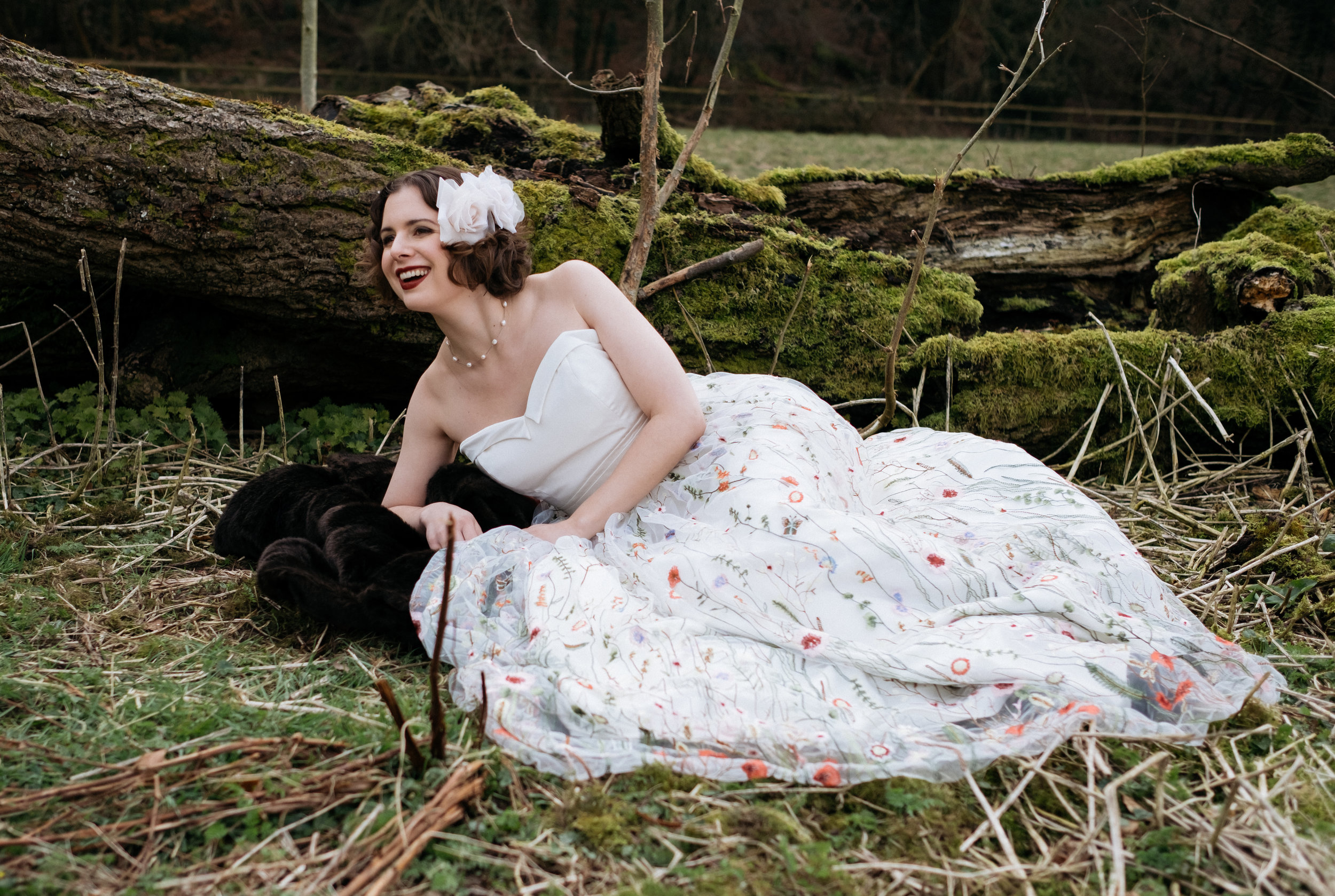 Bride laughing in embroidered wedding dress
