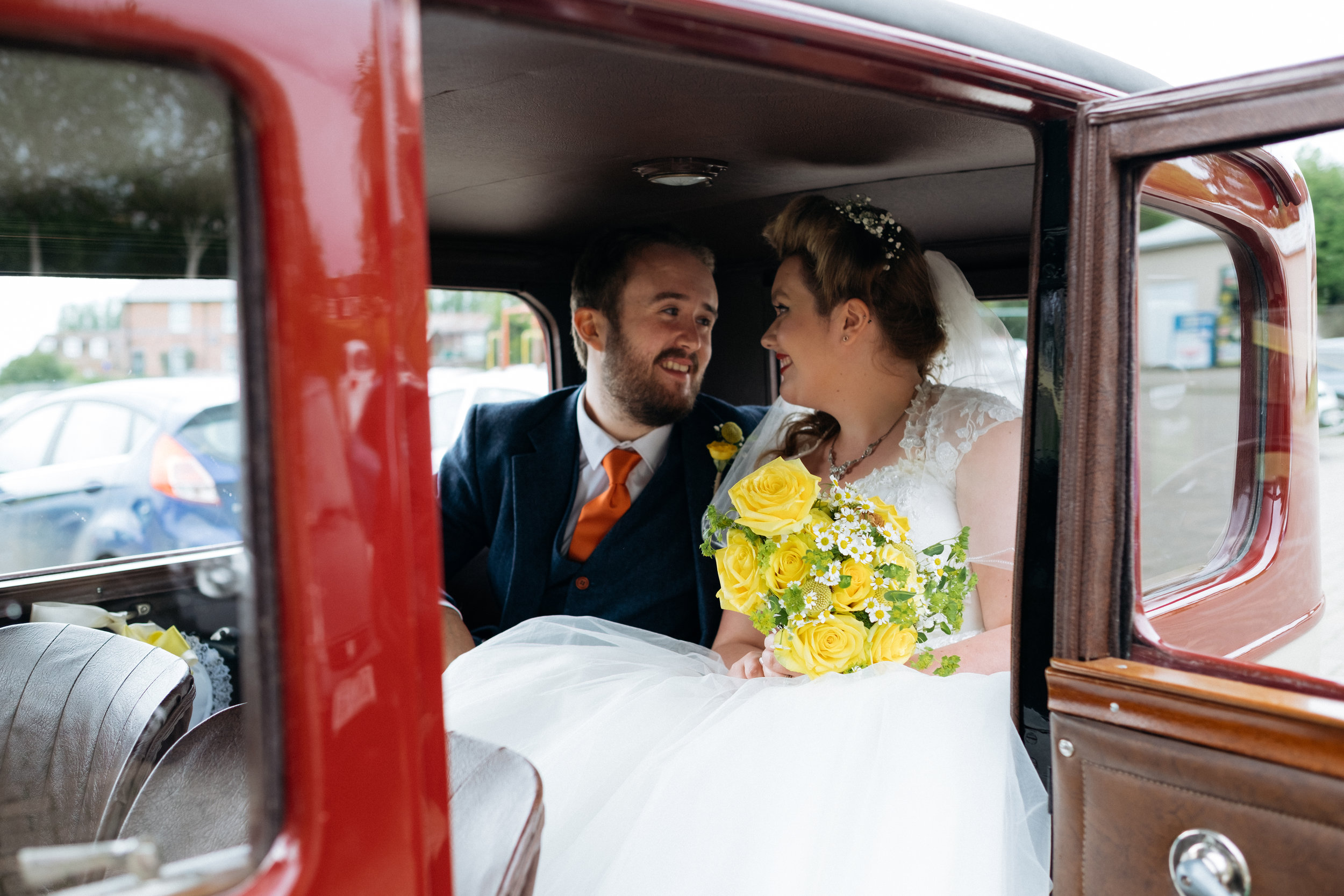 Cute couple in a wedding car